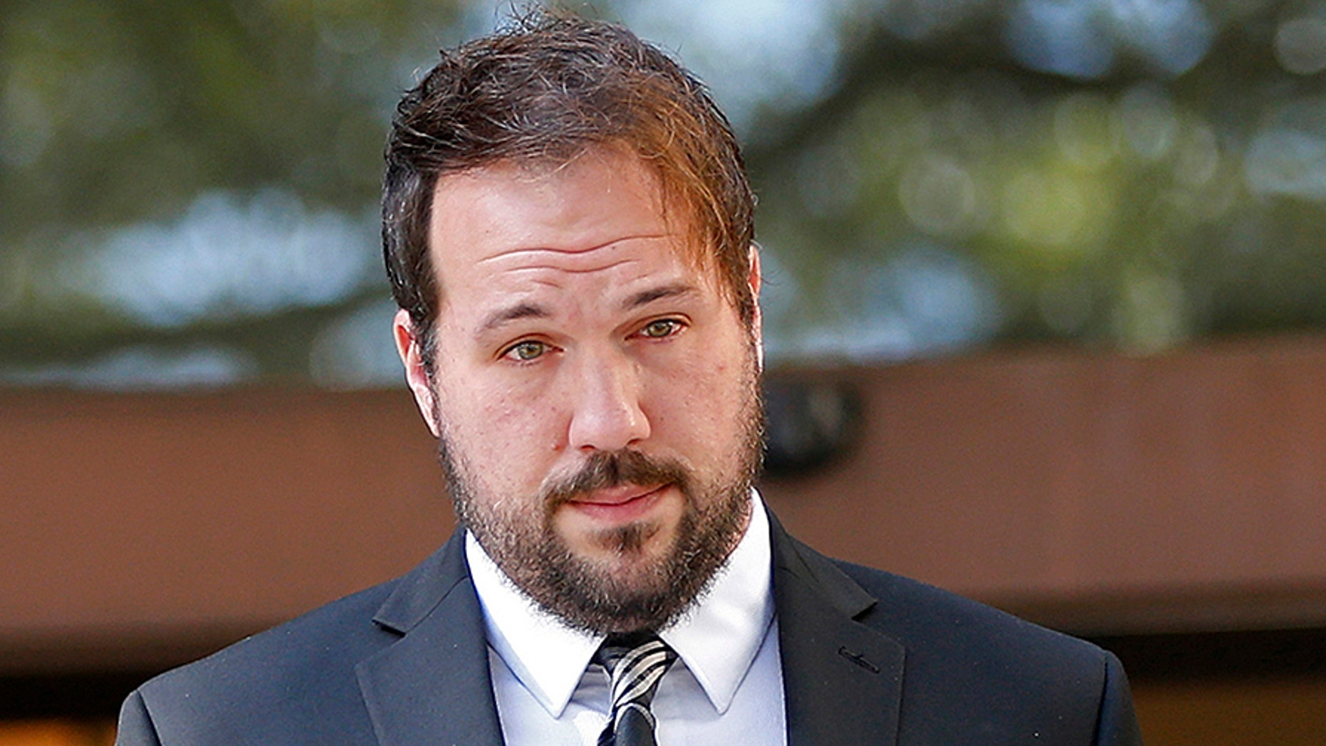 Jordan Hamlett, left, leaves federal court with his attorney Michael Fiser, following his guilty plea in Baton Rouge, La., Monday, Dec. 11, 2017. The Louisiana private investigator pleaded guilty in his alleged attempts to access Donald Trump's tax returns during the presidential campaign. Authorities have said Hamlett failed in his attempts to get Trump's tax returns through a U.S. Department of Education financial aid website. The 32-year-old Lafayette resident was charged with misusing a Social Security number. His trial had been scheduled to start this week, but the judge originally assigned to the case died Saturday. (AP Photo/Gerald Herbert)