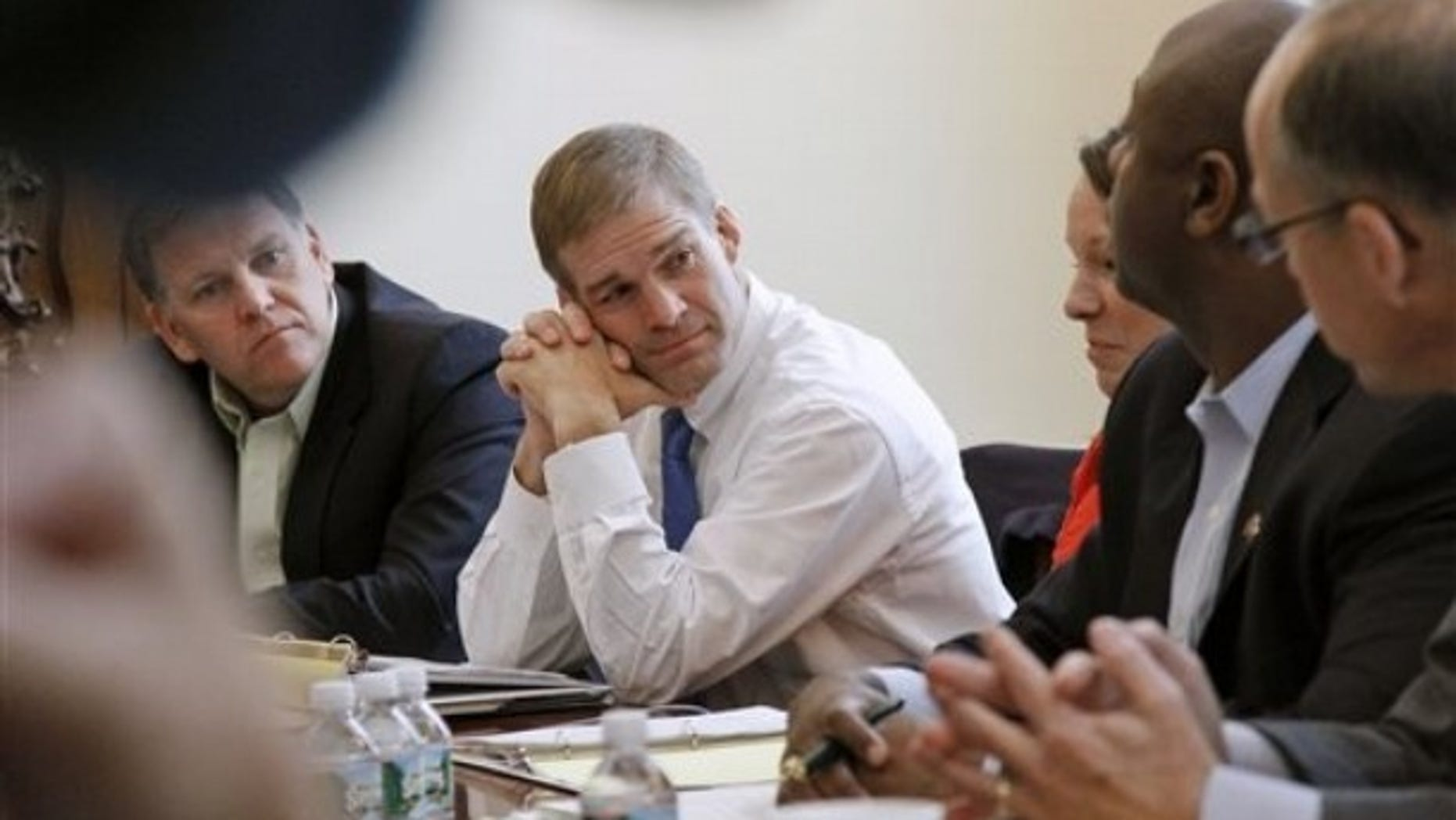 FILE: Nov. 9, 2010: Rep. Jim Jordan, center, meets with other House Republicans on Capitol Hill, in Washington, D.C.