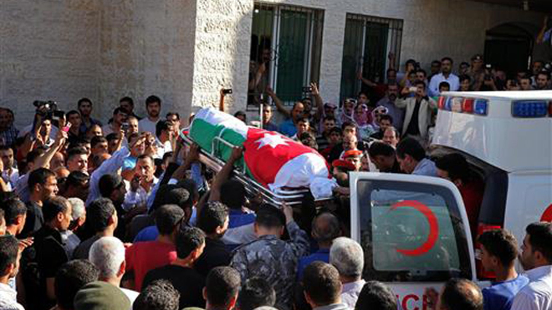 Jordanian soldiers and relatives of Jordanian soldier Belal Al-Zuhbi carry his coffin near the city of Jerash, north of Amman, Jordan, Tuesday, June 21, 2016.