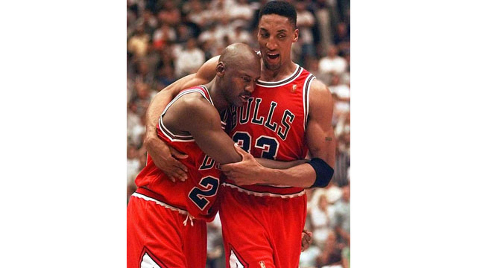 June 11, 1997: Scottie Pippen, right, helps Michael Jordan off the floor following Game 5 of the NBA Finals between the Chicago Bulls and Utah Jazz. Jordan scored 38 points in Chicago's 90-88 win despite playing with a severe stomach flu. (AP Photo)
