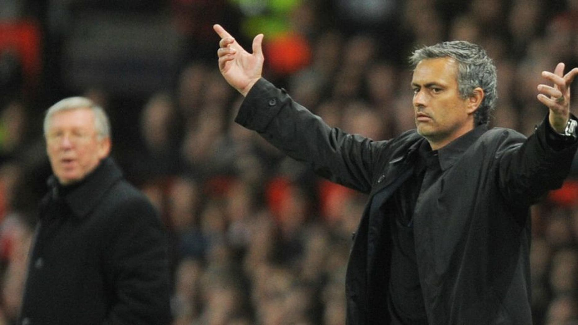 Inter Milan's Portuguese coach Jose Mourinho (R) gestures next to Manchester United manager Sir Alex Ferguson during their UEFA Champions League second round second leg football match at Old Trafford in Manchester, north west England on March 11, 2009. AFP PHOTO/ANDREW YATES (Photo credit should read ANDREW YATES/AFP/Getty Images)