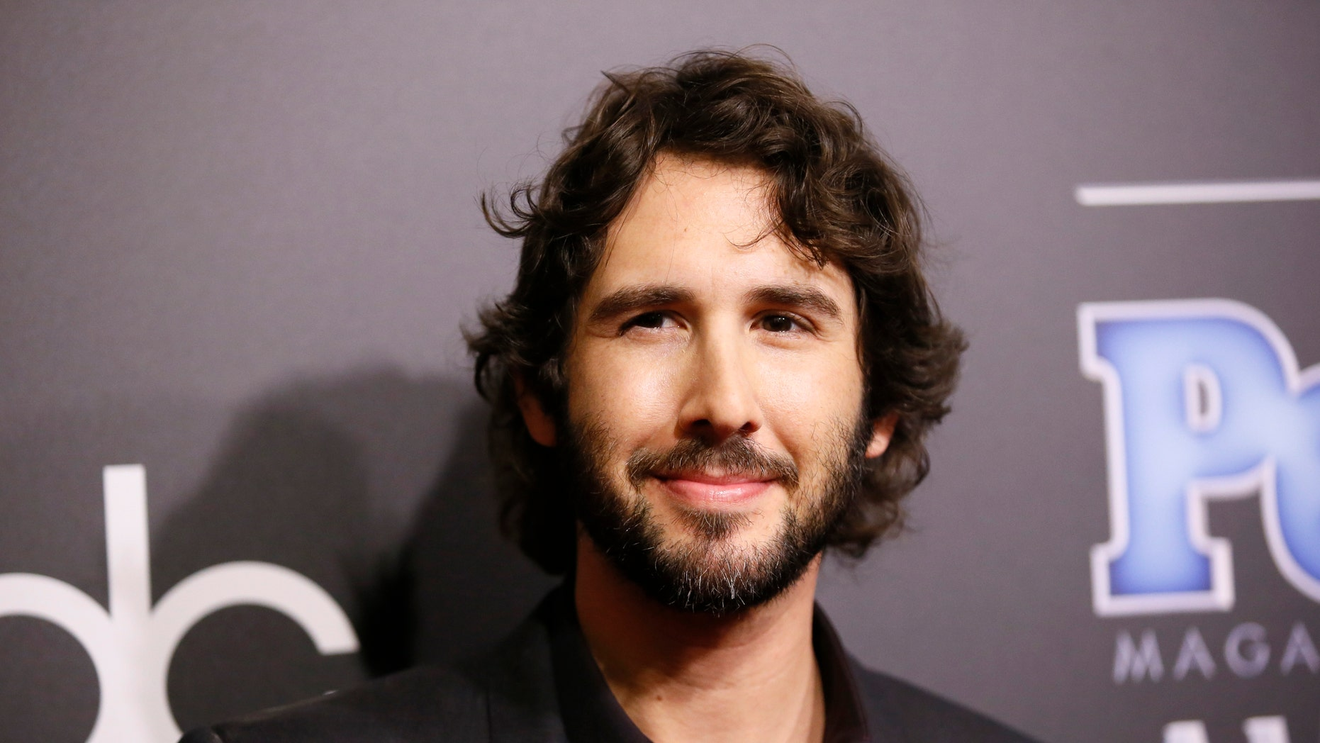 Musician Josh Groban arrives at the People Magazine Awards in Beverly Hills, California December 18, 2014.   REUTERS/Danny Moloshok (UNITED STATES  - Tags: ENTERTAINMENT)   - RTR4IMFZ