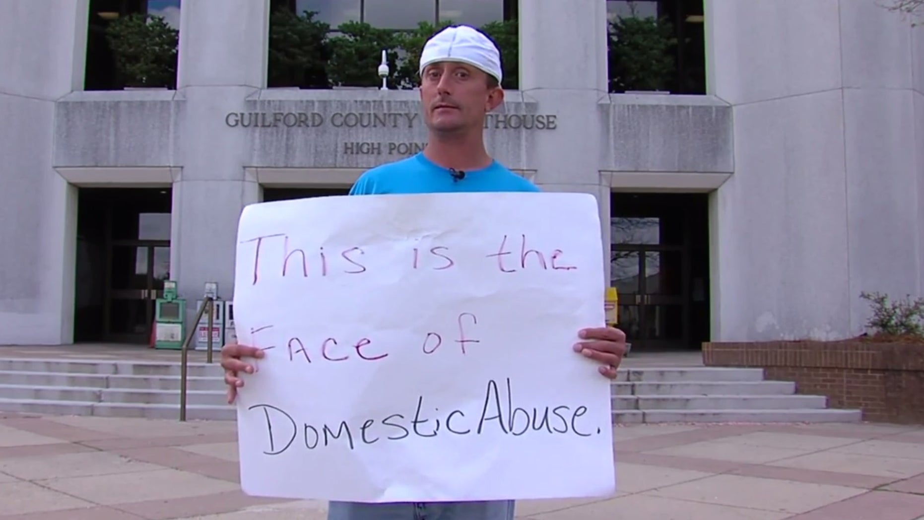Josh Hill standing outside the courthouse.