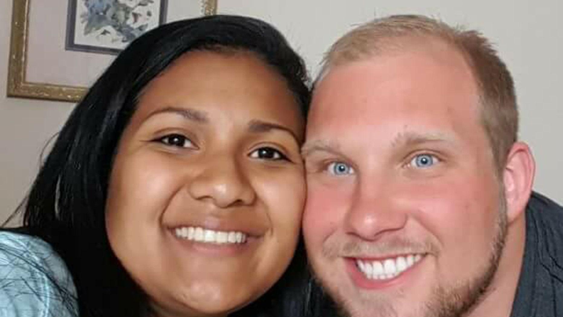 Thamara Caleño, left, and her husband, Joshua Holt.