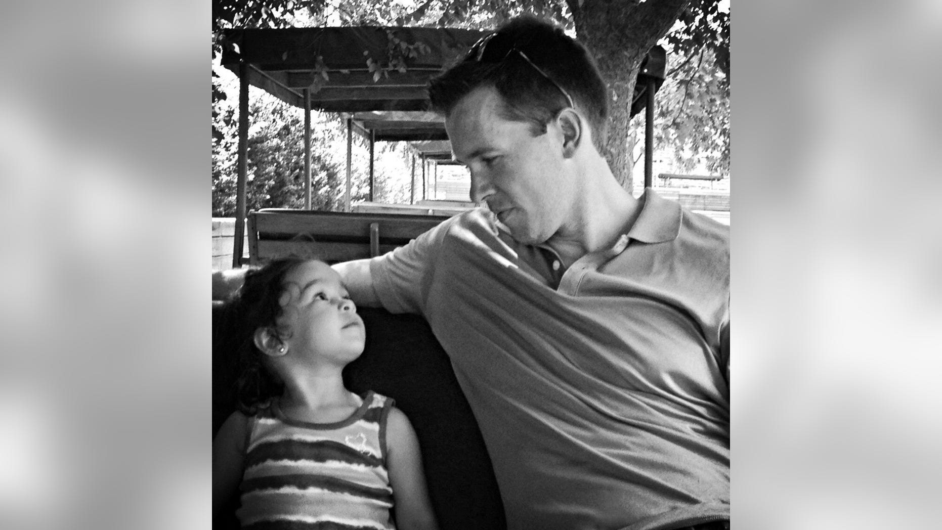 Joshua Rogers and his daughter.