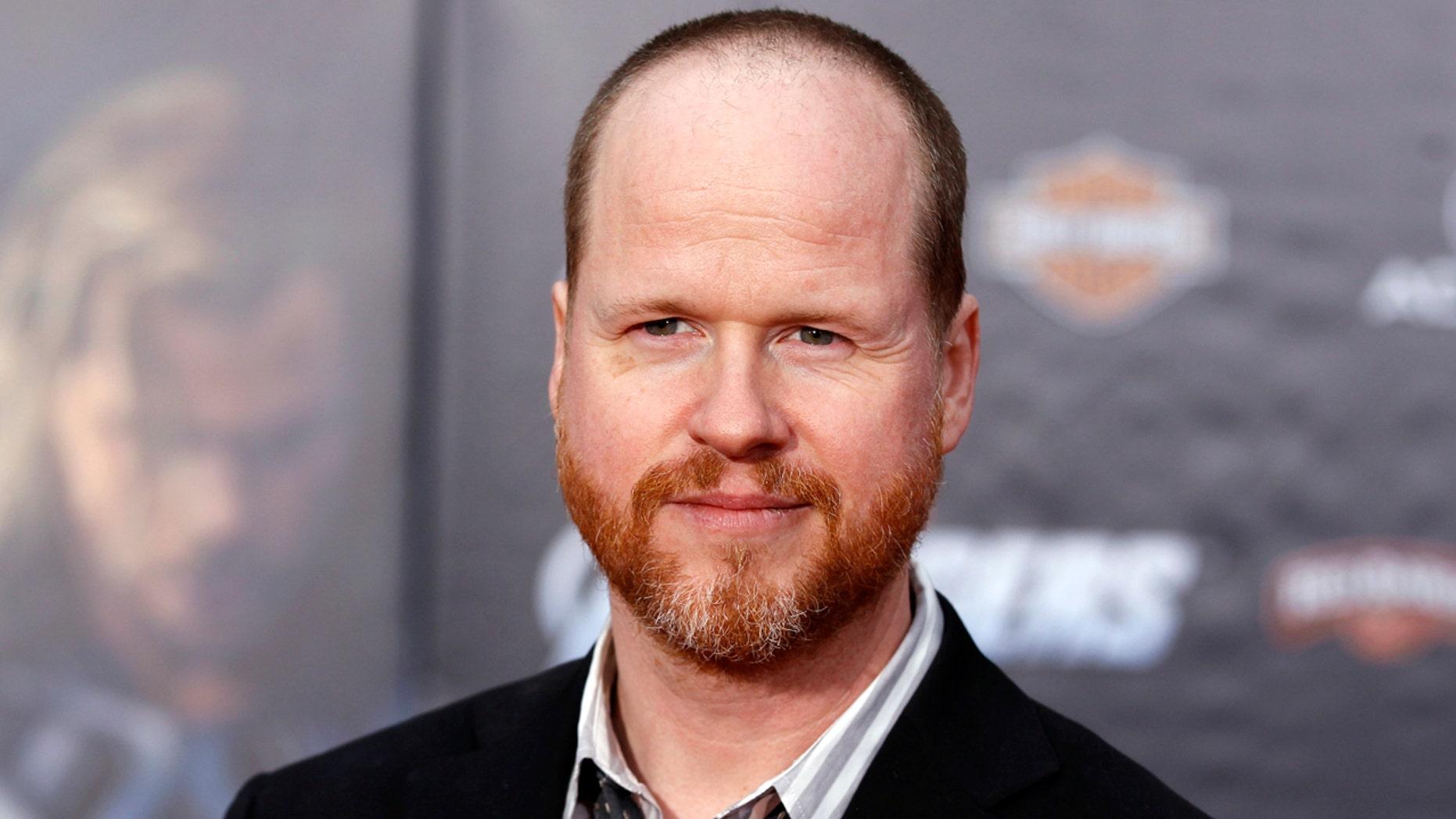 """Director Joss Whedon poses at the world premiere of the film """"Marvel's The Avengers"""" in Hollywood, California April 11, 2012. REUTERS/Danny Moloshok (UNITED STATES - Tags: ENTERTAINMENT) - GM1E84C10L601"""