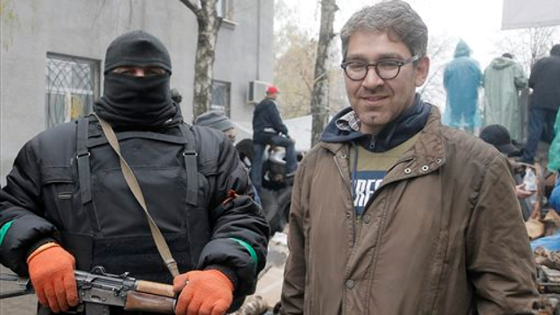 April 13, 2014: A reporter Simon Ostrovsky, right, stands next to a Pro-Russian gunman at a seized police station in the eastern Ukraine town of Slovyansk.