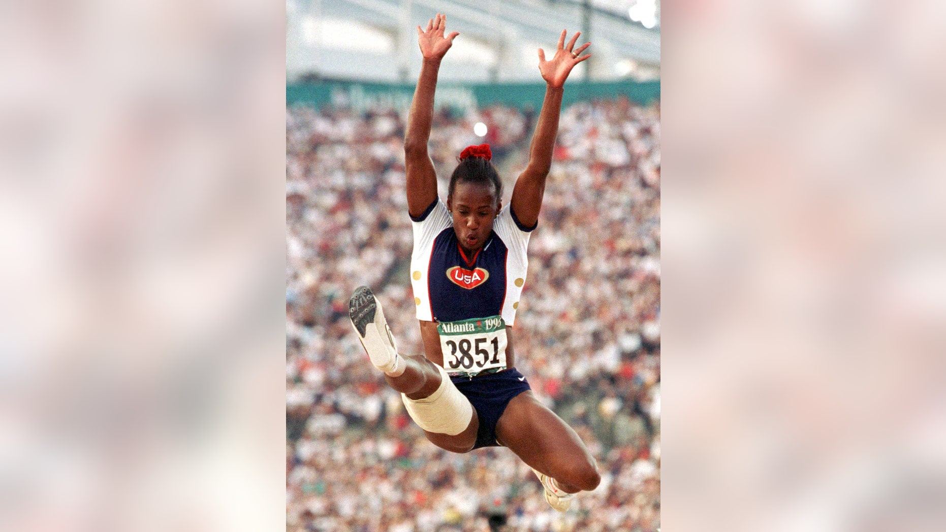 Jackie Joyner-Kersee of the United States competes in the finals of the women's long jump competition Aug. 2, 1996 at the Olympic stadium in Atlanta (Reuters).