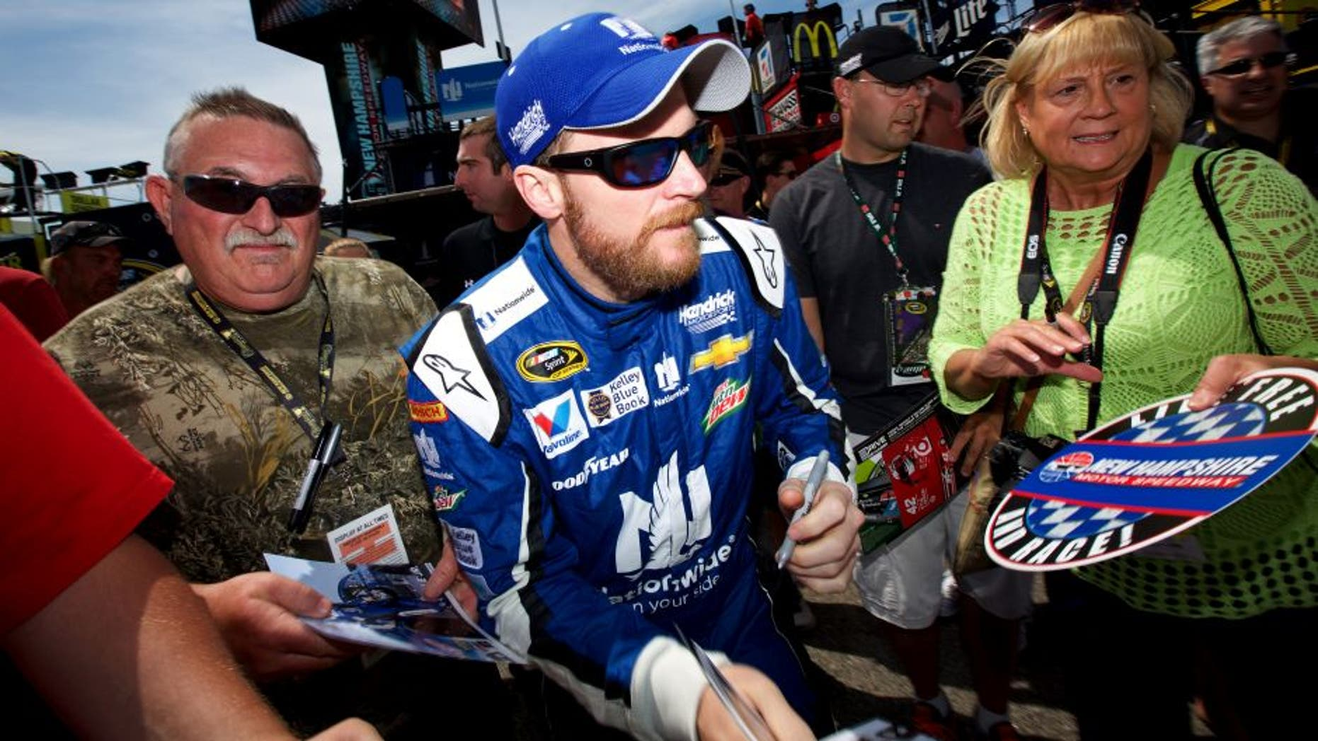LOUDON, NH - JULY 17: Dale Earnhardt Jr., driver of the #88 Nationwide Chevrolet, signs autographs for fans during practice for the NASCAR Sprint Cup Series 5-Hour Energy 301 at New Hampshire Motor Speedway on July 17, 2015 in Loudon, New Hampshire. (Photo by Nick Laham/Getty Images)