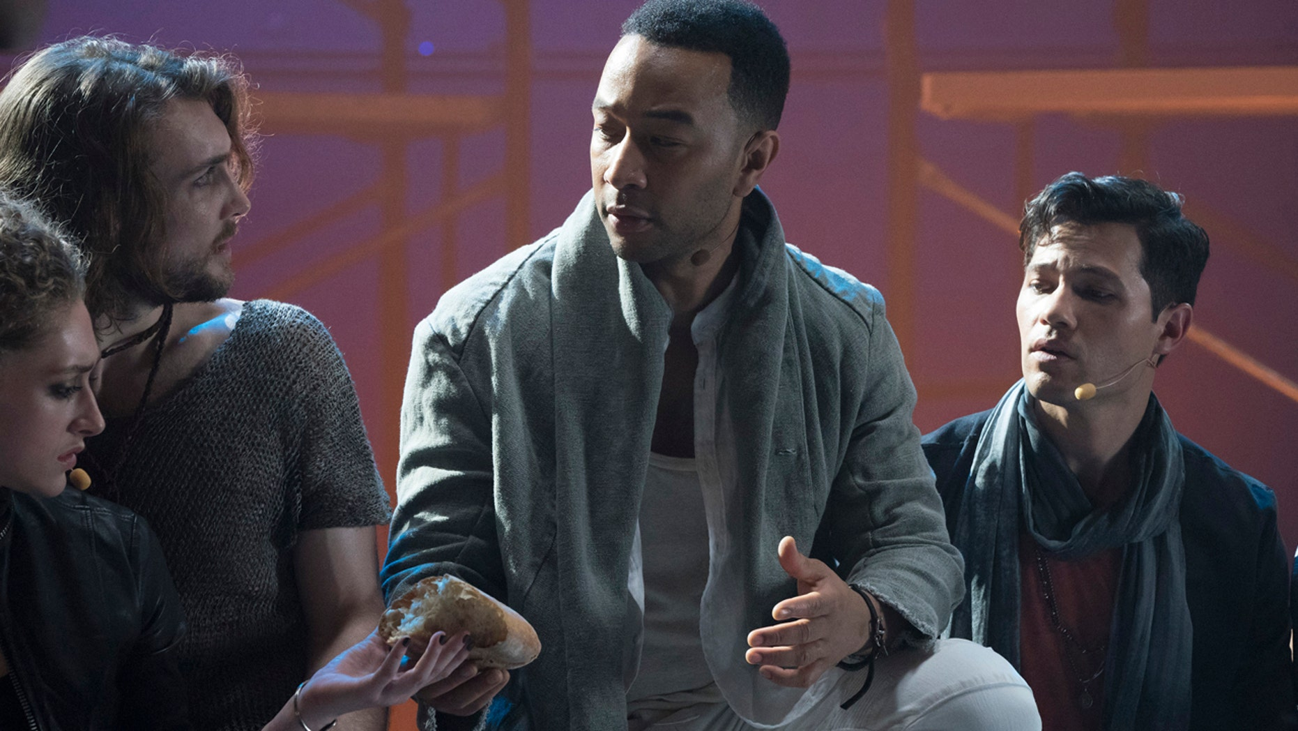 "JESUS CHRIST SUPERSTAR LIVE IN CONCERT -- ""Promo Shoot"" -- Season: 2018 --  Pictured: (l-r) Ensemble, John Legend as Jesus Christ, Jason Tam as Peter -- (Photo by: Virginia Sherwood/NBC)"