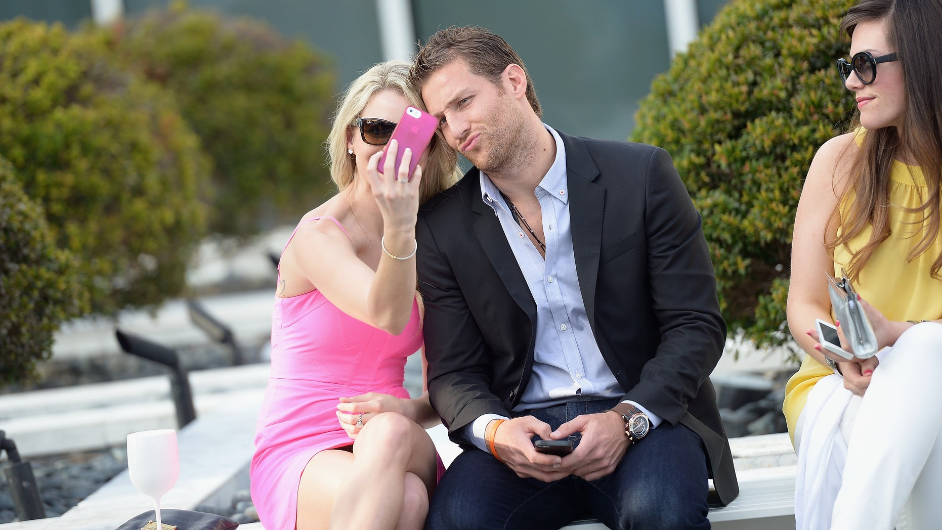 """Nikki Ferrell and Juan Pablo Galavis attends the Moet & Chandon """"Tiny Tennis"""" With Roger Federer at Club 50 at Viceroy Miami on March 19, 2014 in Miami, Florida."""