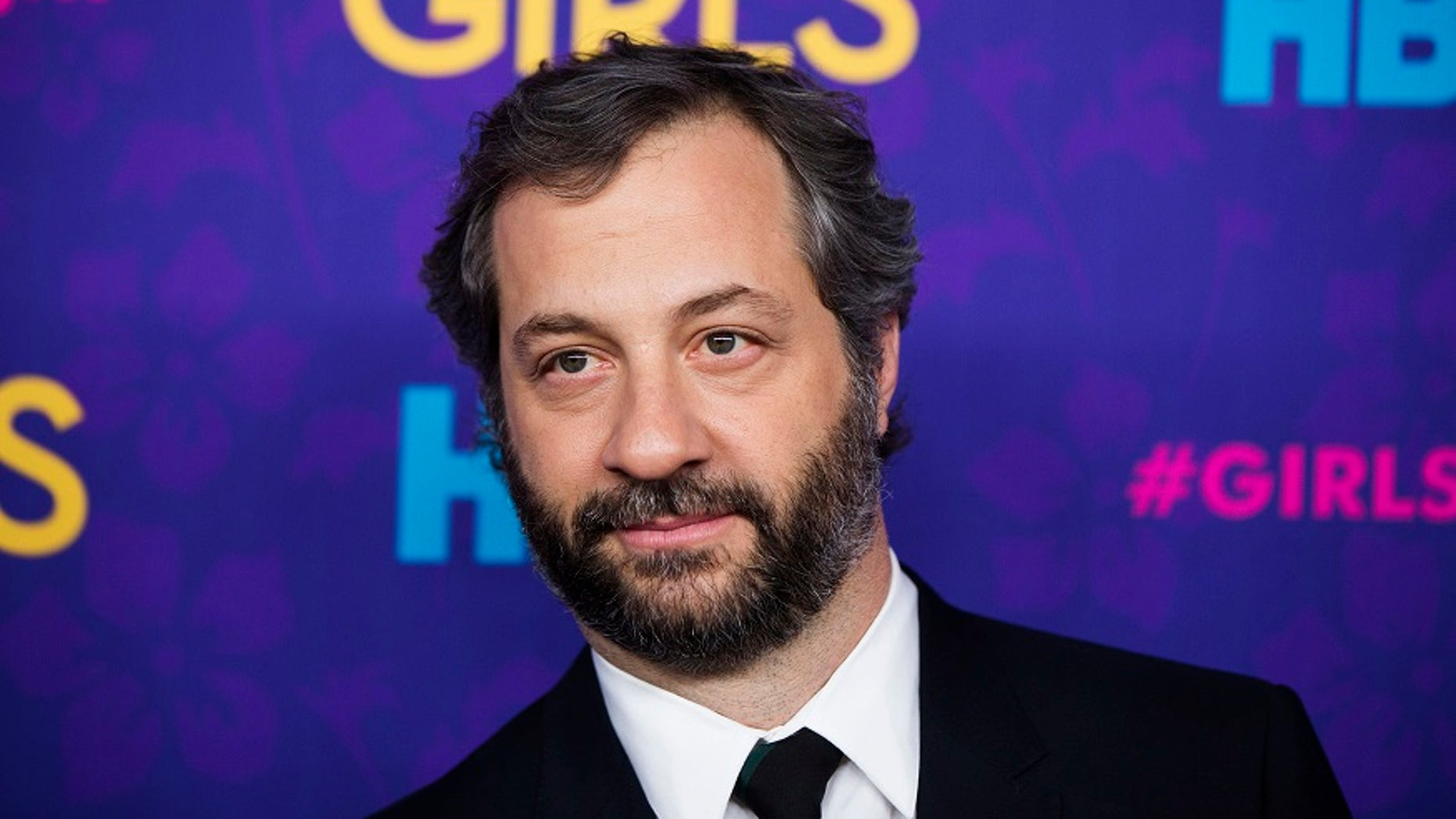 Judd Apatow took to Twitter to slam President Trump over his digs at the late  John McCain