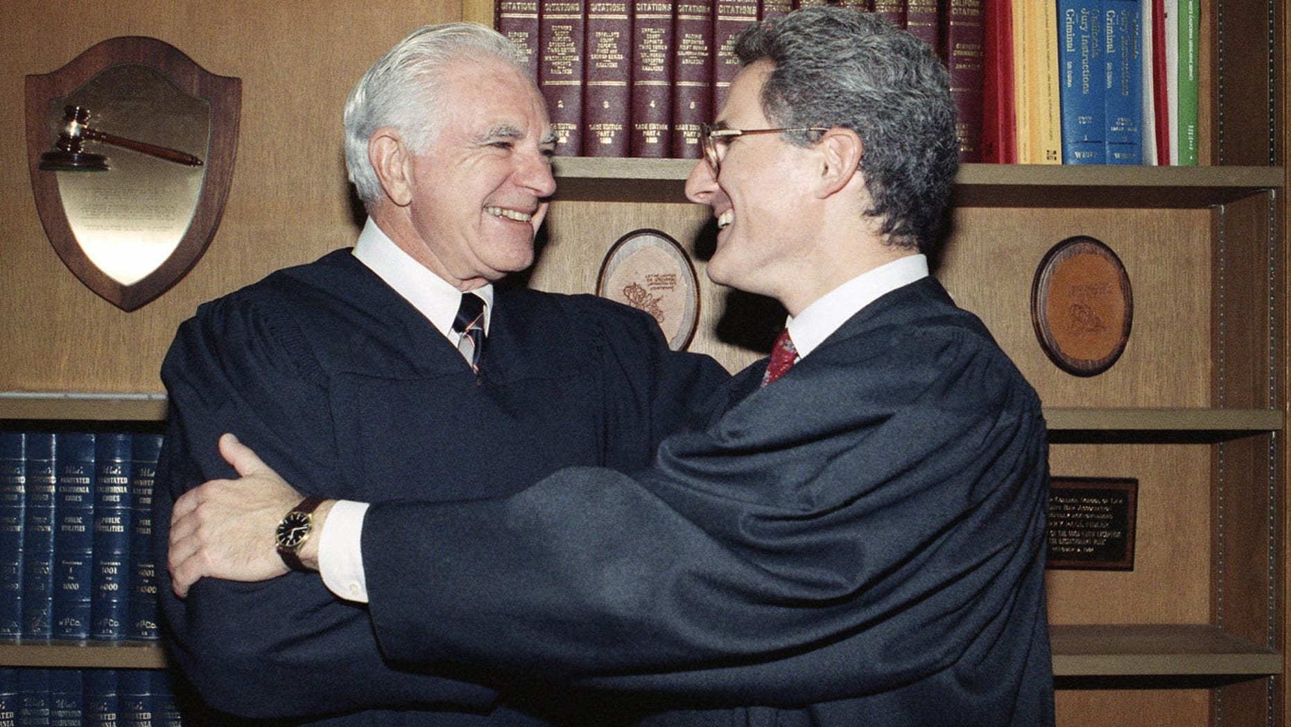Oct. 13, 1989: Retired Judge Joseph A. Wapner of TV's 'The People's Court' congratulates his son, Judge Frederick N. Wapner, right, as he was enrobed as a Municipal Court judge in Los Angeles.