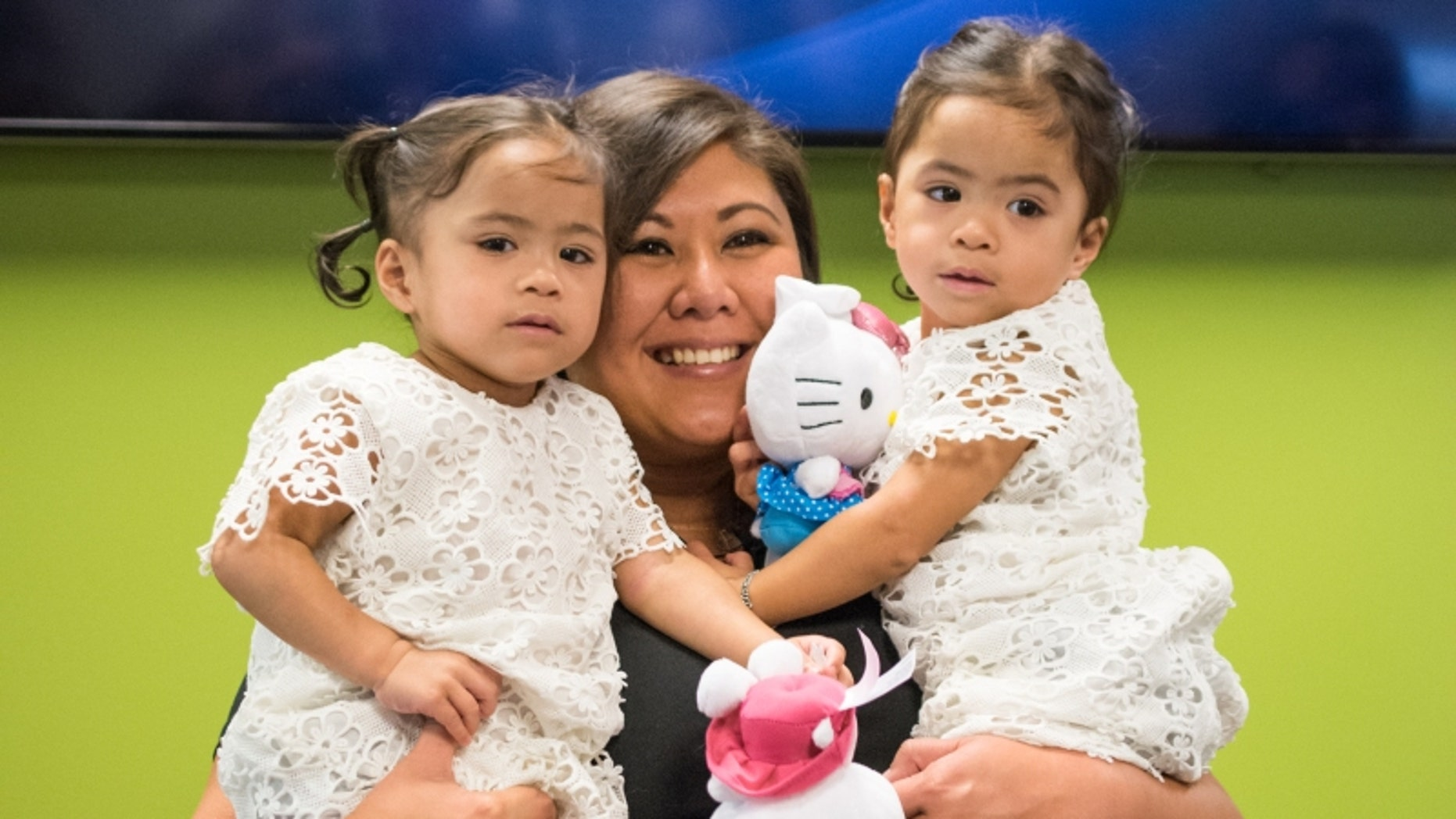 Zoey and Zayne Espayos are pictured with Judiel Ennis.