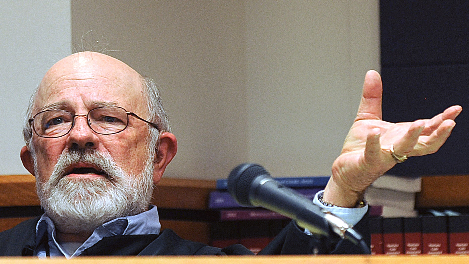 In this undated file photo, District Judge G. Todd Baugh presides at a hearing in Great Falls, Mont.