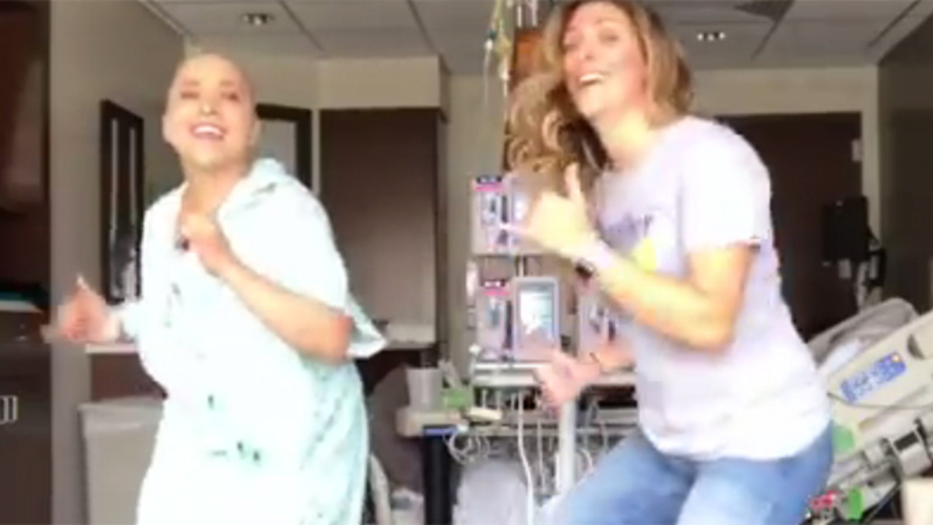 Ana-Alecia Ayala, left, and her dance partner have gone viral for their 'Juju on That Chemo' dance.
