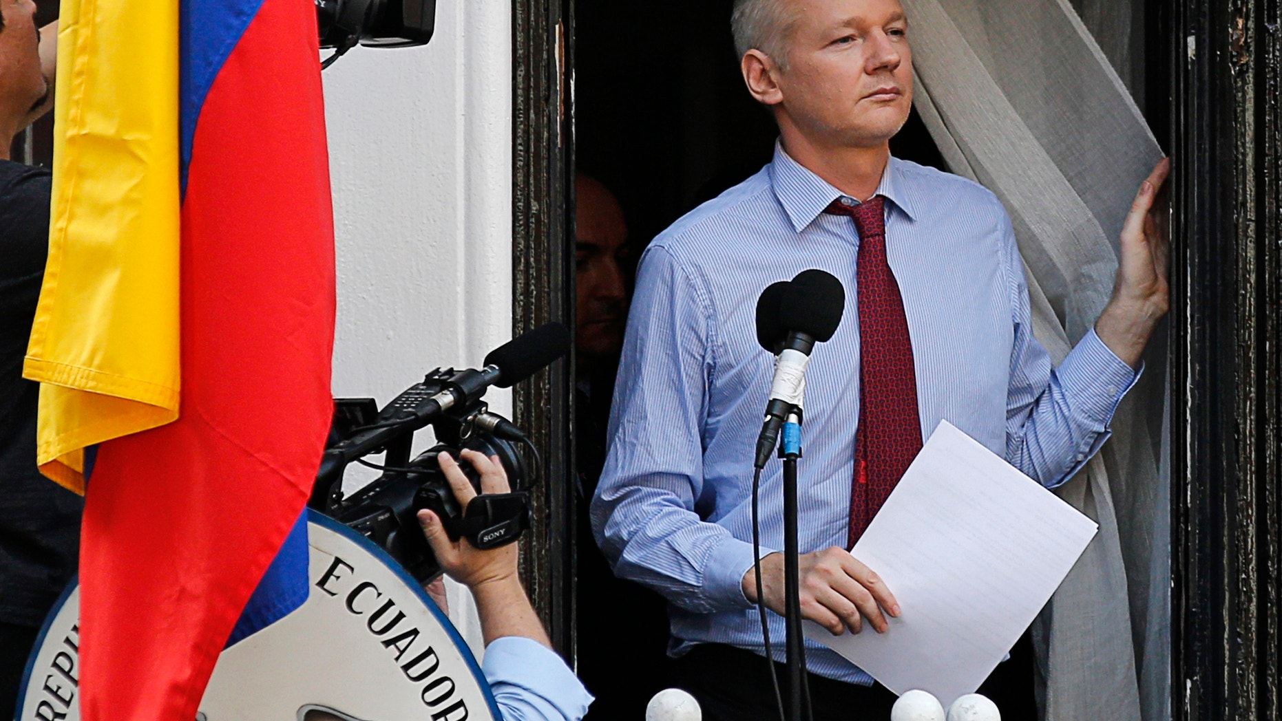 Wikileaks founder Julian Assange arrives to speak from the balcony of Ecuador's embassy, where he is taking refuge in London August 19, 2012.