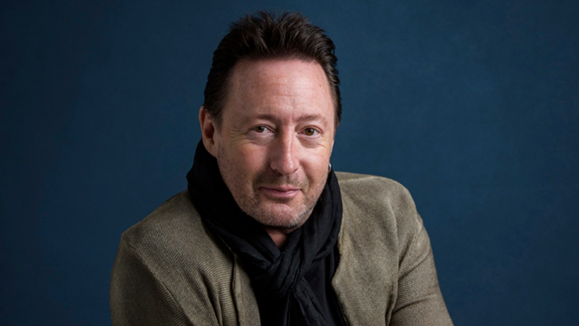 """Julian Lennon has a children's book """"Touch the Earth"""" coming out."""