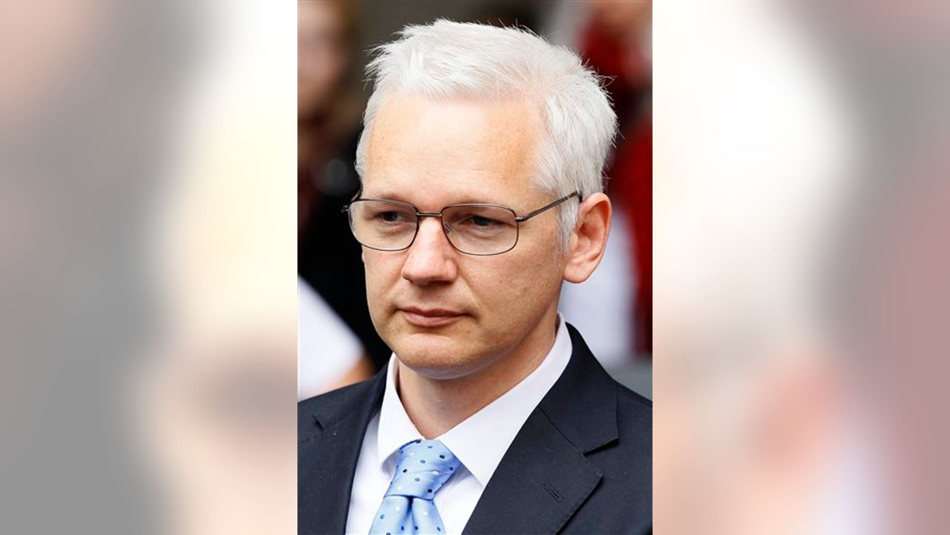 Tuesday, July 12: Wikileaks founder, Julian Assange leaves court after his extradition appeal hearing.