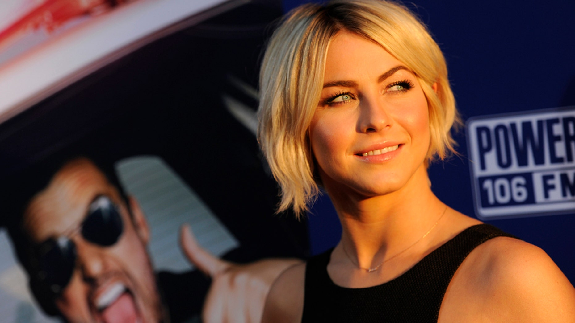 """Actress Julianne Hough looks back for photographers at the premiere of the film """"Let's Be Cops"""" on Thursday, Aug. 7, 2014, in Los Angeles."""