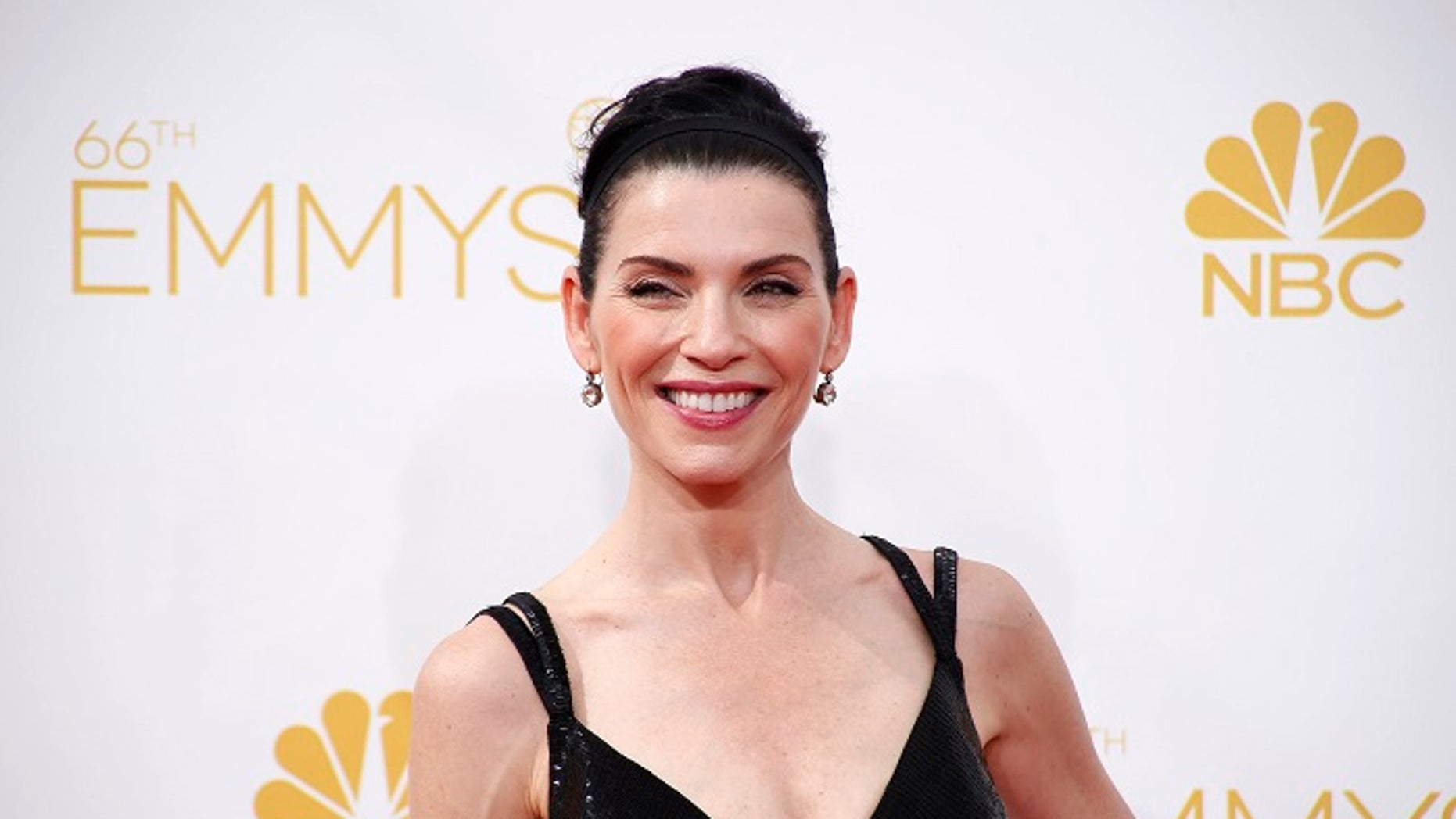 """The Good Wife"" star Julianna Margulies said she had uncomfortable hotel room encounters with both Harvey Weinstein and Steven Seagal."