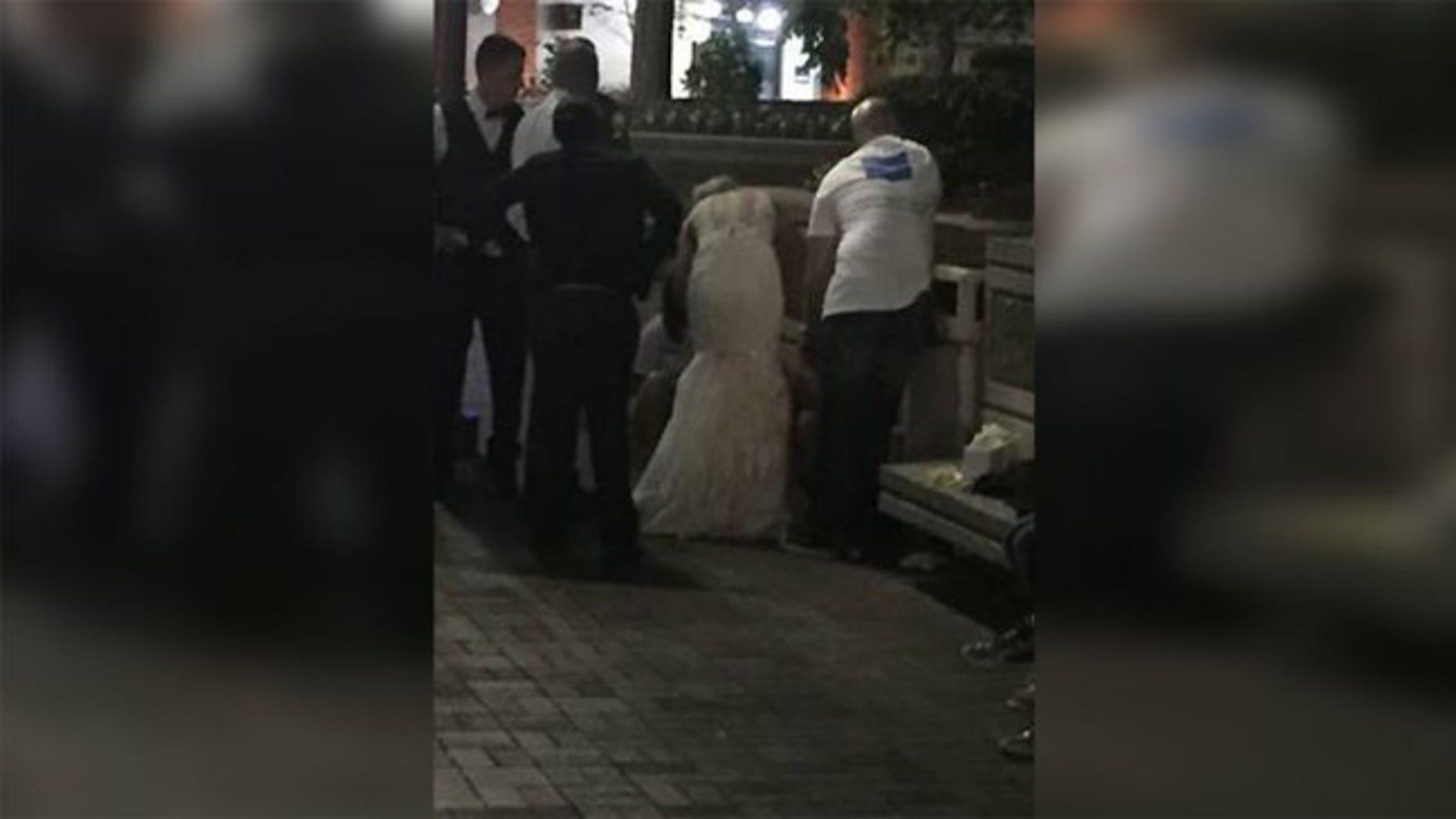 Julie Stroyne performed CPR on a stranger outside of her wedding reception.