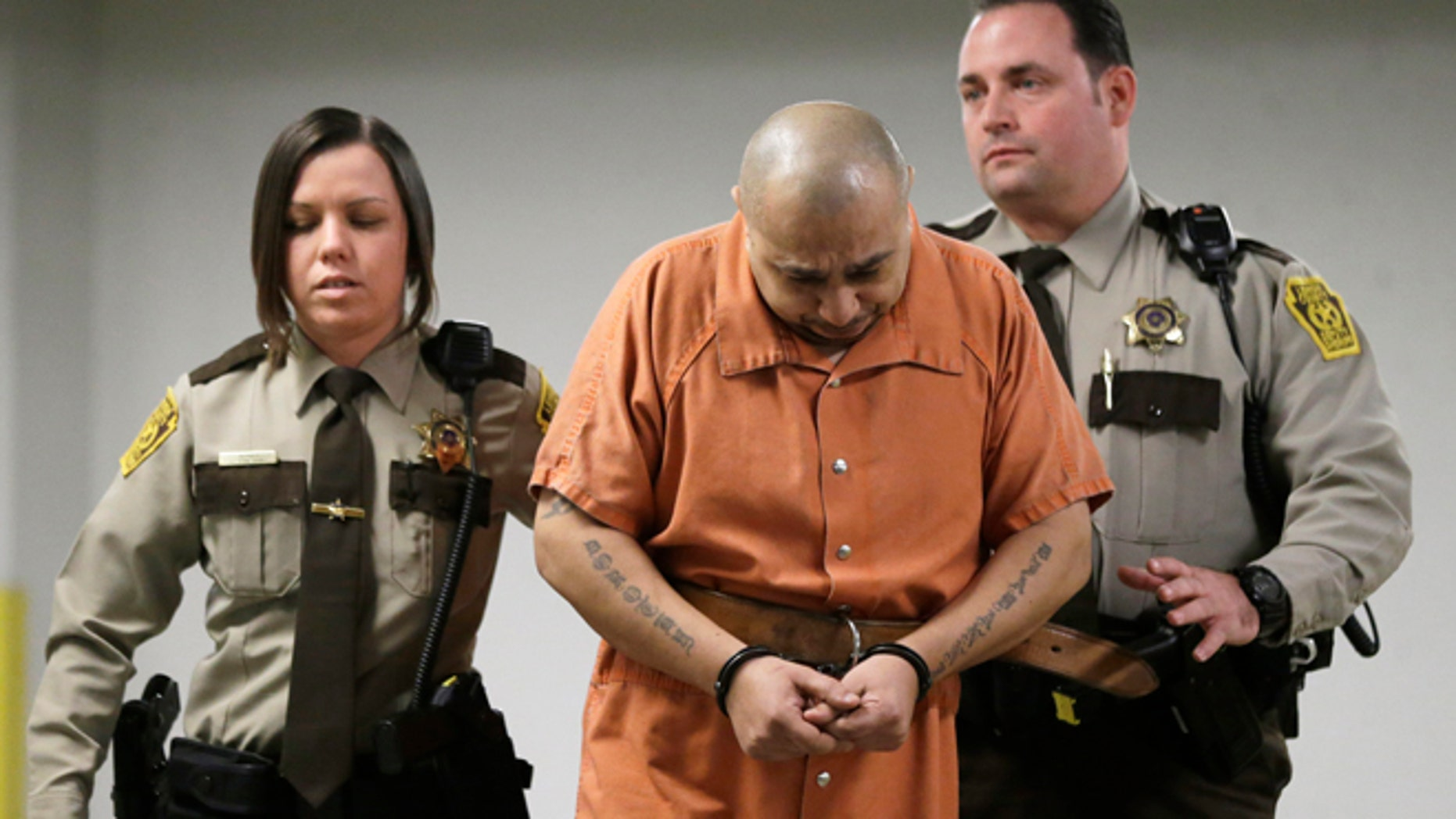 March 7, 2013: Julio Acevedo is escorted to a hearing at the Lehigh County Courthouse in Allentown, Pa. Acevedo was arrested in Pennsylvania on Wednesday after a friend arranged his surrender and was ordered held without bail. He is a suspect in a hit-and-run crash that killed a pregnant woman and her husband on their way to a hospital in New York. Their premature baby, delivered after the crash, later died.