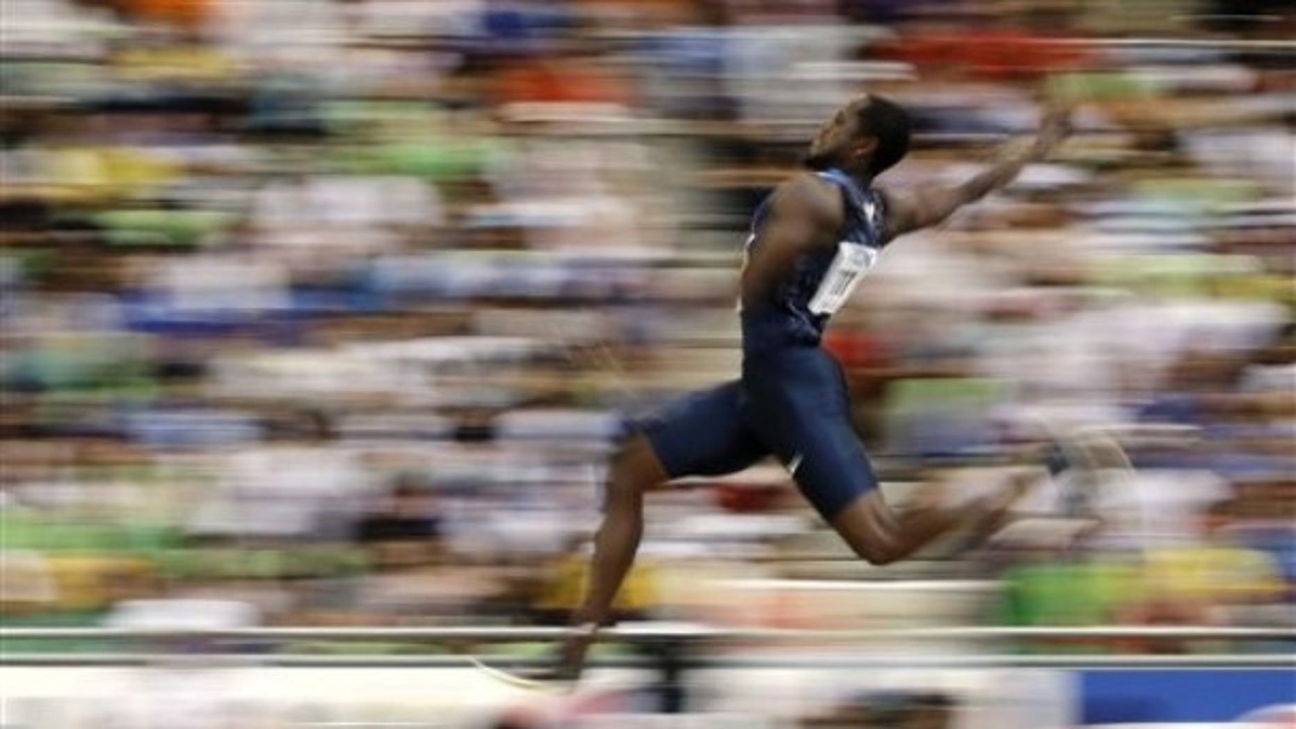 USA's Dwight Phillips competes in a Men's Long Jump qualification round at the World Athletics Championships in Daegu, South Korea, Thursday, Sept. 1, 2011. (AP Photo/David J. Phillip)