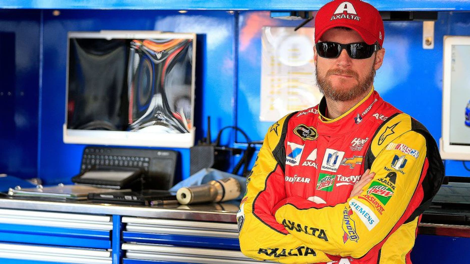 AVONDALE, AZ - MARCH 11: Dale Earnhardt Jr, driver of the #88 Axalta Chevrolet, stands in the garage area during practice for the NASCAR Sprint Cup Series Good Sam 500 at Phoenix International Raceway on March 11, 2016 in Avondale, Arizona. (Photo by Chris Trotman/Getty Images)