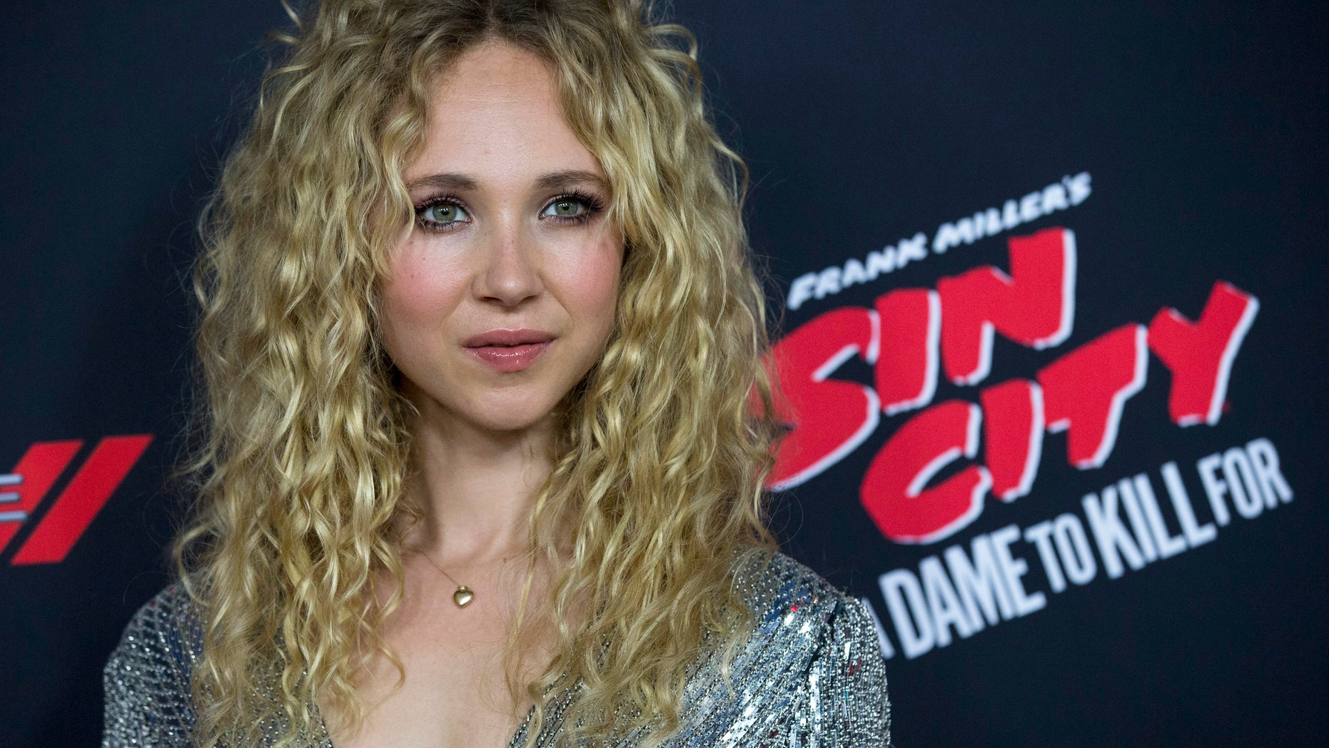 "August 19, 2014. Cast member Juno Temple poses at the premiere of ""Sin City: A Dame to Kill For"" in Hollywood."