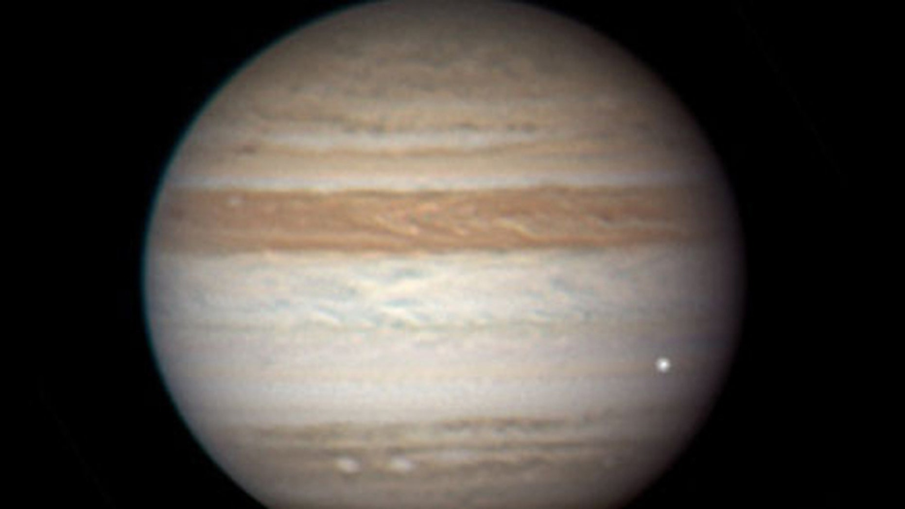 This photo of Jupiter taken June 3, 2010 by Australian amateur astronomer Anthony Wesley shows a bright fireball from an apparent meteor or other object. Skywatcher Christopher Go of the Philippines also caught the event on video.