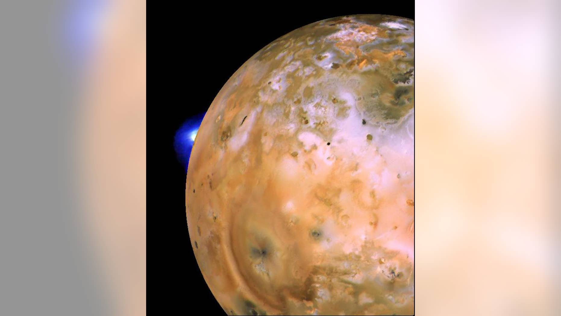 Voyager 1 image of Jupiter's volcanic moon Io showing the active plume of a volcano called Loki. Th heart-shaped feature southeast of Loki consists of fallout deposits from active plume Pele. The images that make up this mosaic were taken from an average distance of about 340,000 miles (490,000 kilometers).