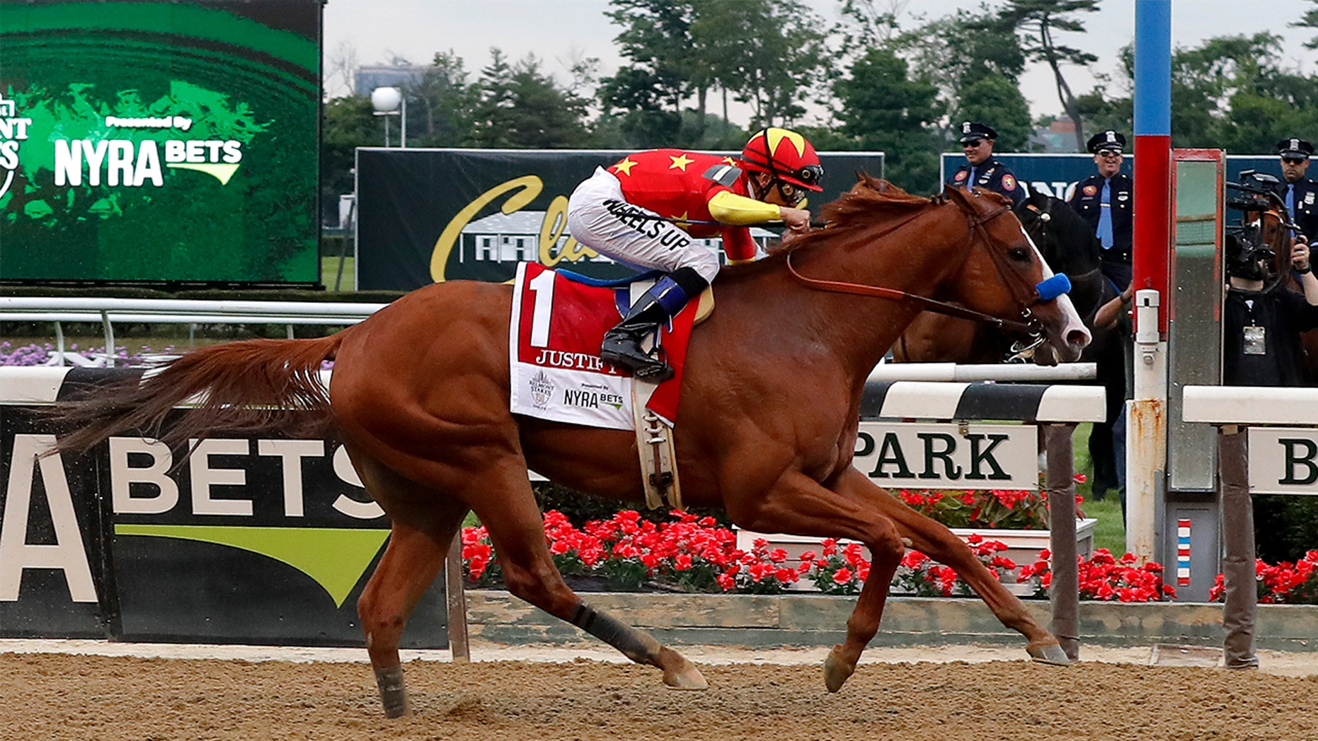 Justify (1), with jockey Mike Smith, crosses the finish line to win the 150th running of the Belmont Stakes horse race, Saturday, June 9, 2018, in Elmont, N.Y.