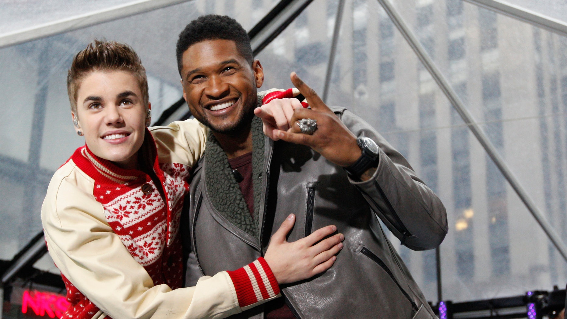 """November 23, 2011. Singers Justin Bieber and Usher (R) pose together after performing on NBC's """"Today"""" show in New York."""
