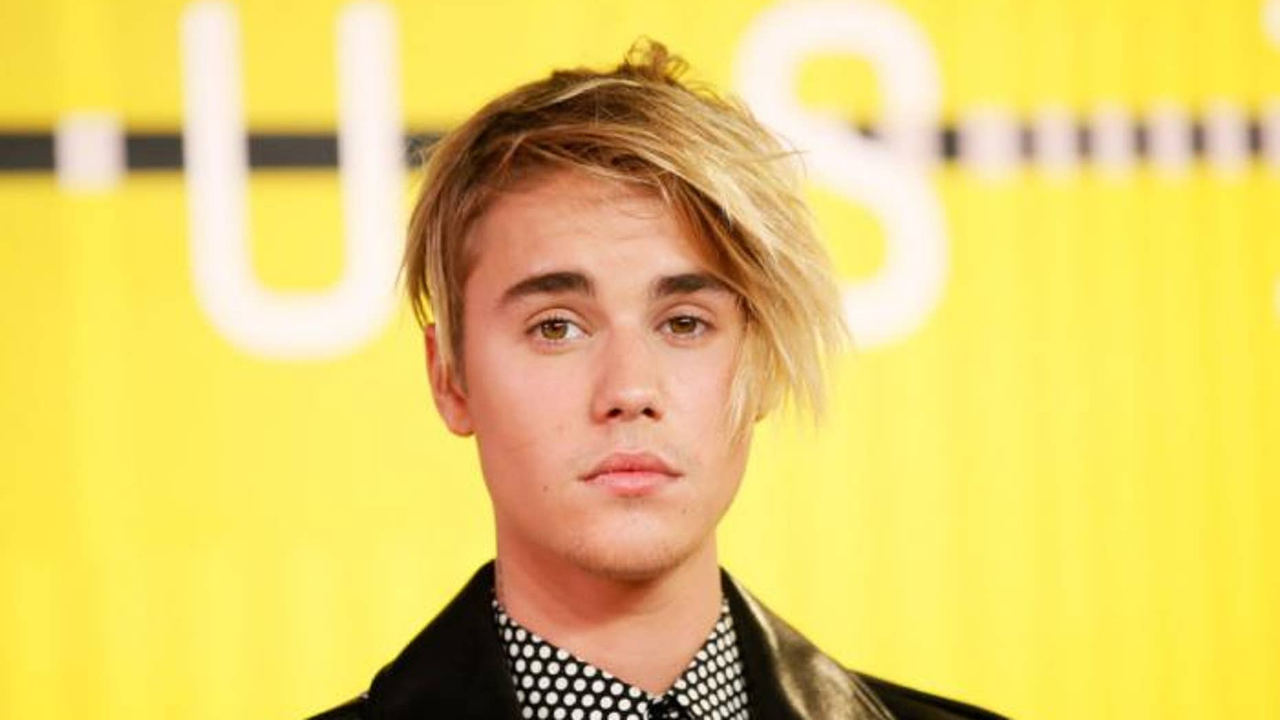 Justin Bieber settles a long-running lawsuit filed by ex-neighbor whose house he egged.