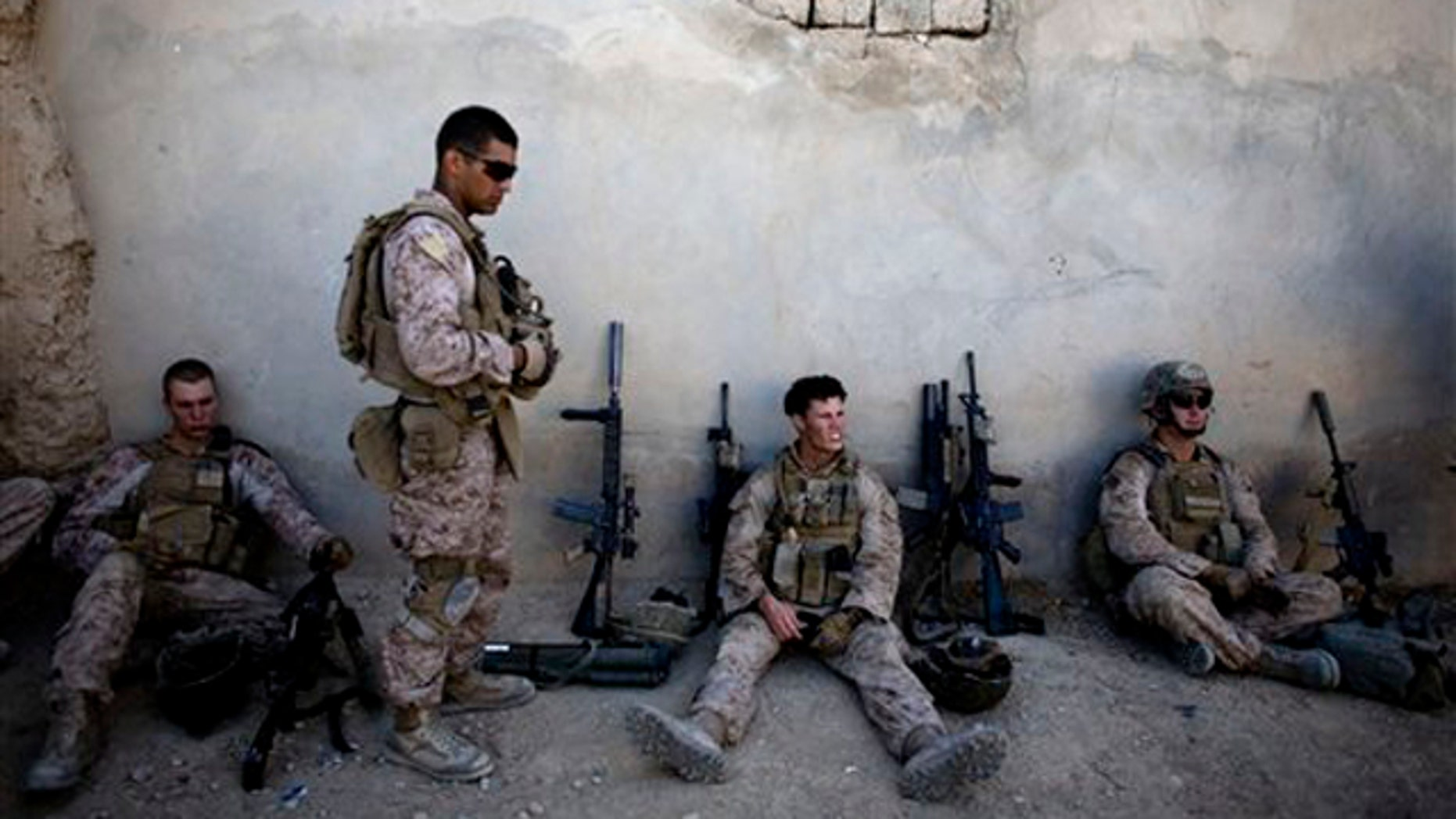 Marines with India company, 3rd Battalion 5th Marines, First Marine Division, take a break during a patrol in Sangin, south of Kabul, Afghanistan on Nov. 3. (AP Photo)