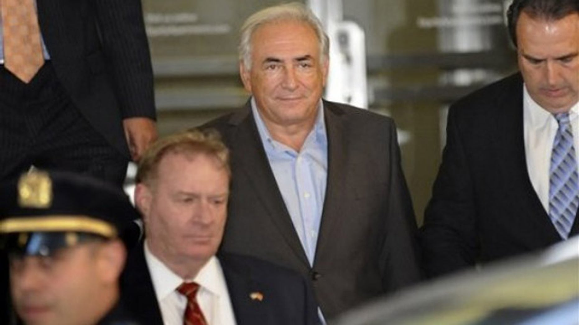 May 25: Dominique Strauss-Kahn, center, is led from 71 Broadway in Manhattan's financial district where the former International Monetary Fund leader was staying following his release on bail (AP).