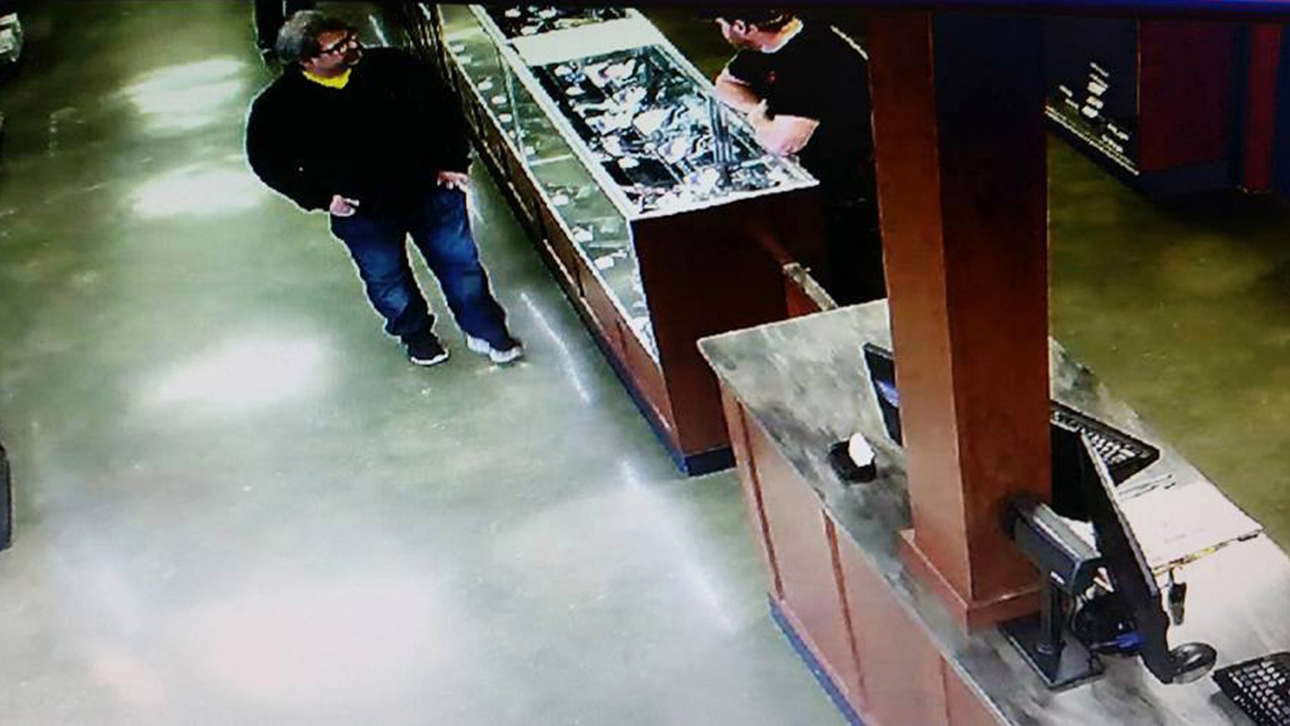 Feb. 20, 2016: In this photo provided by Southwick's gun store, Jason Dalton, left, appears in the store in Plainwell, Mich., hours before he went on a shooting rampage. (Southwick's Gun Store via AP)