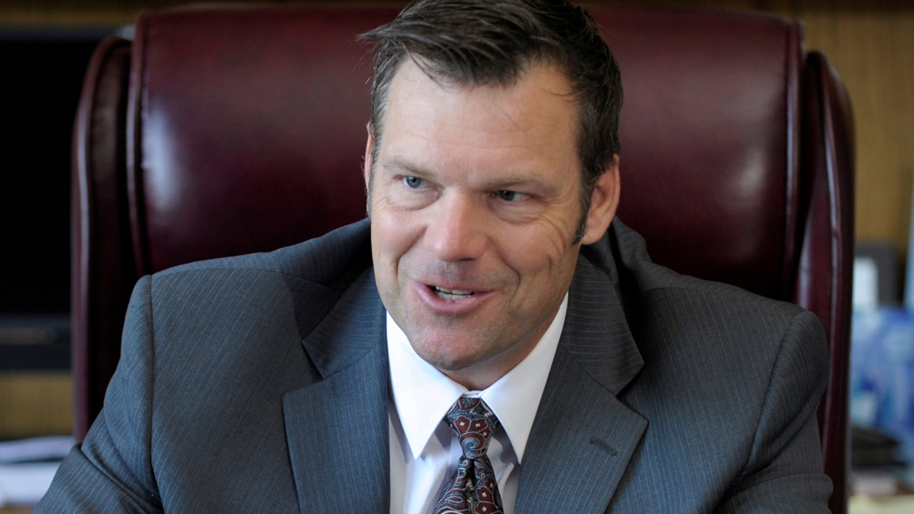 Kansas Secretary of State Kris Kobach talks about the Kansas voter ID law that he pushed to combat what he believes to be rampant voter fraud in the United States in his Topeka, Kansas, U.S., office May 12, 2016. REUTERS/Dave Kaup TPX IMAGES OF THE DAY      - D1BETHJUBZAA