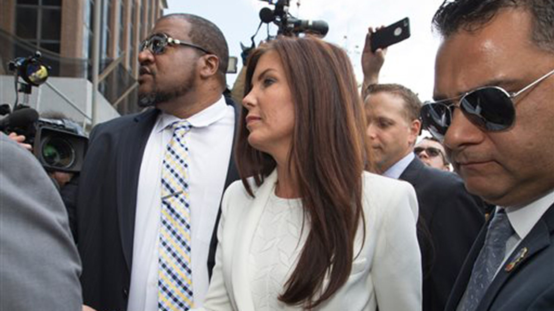 Aug. 8, 2015: Pennsylvania Attorney General Kathleen Kane arrives to be processed and arraigned on charges she leaked secret grand jury material and then lied about it under oath at the Montgomery County detective bureau in Norristown, Pa.