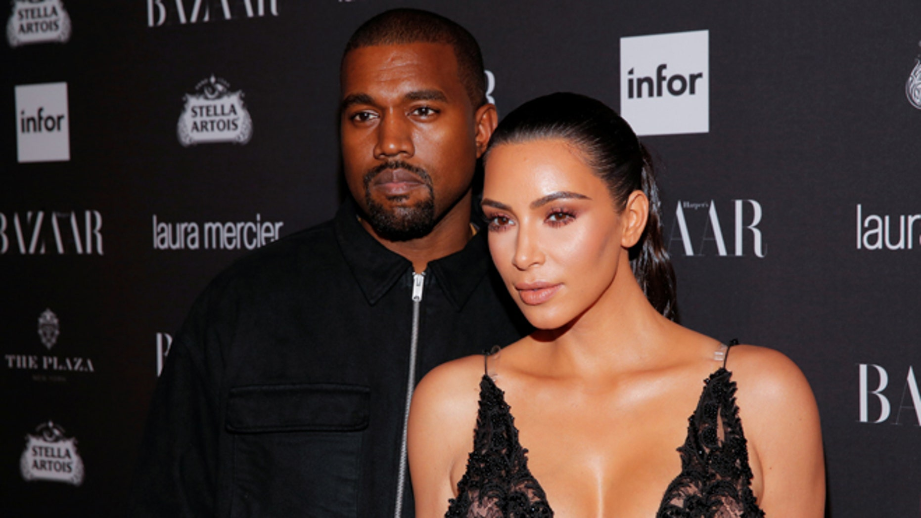 Kanye West spent Thanksgiving in the hospital with wife Kim Kardashian by his side.
