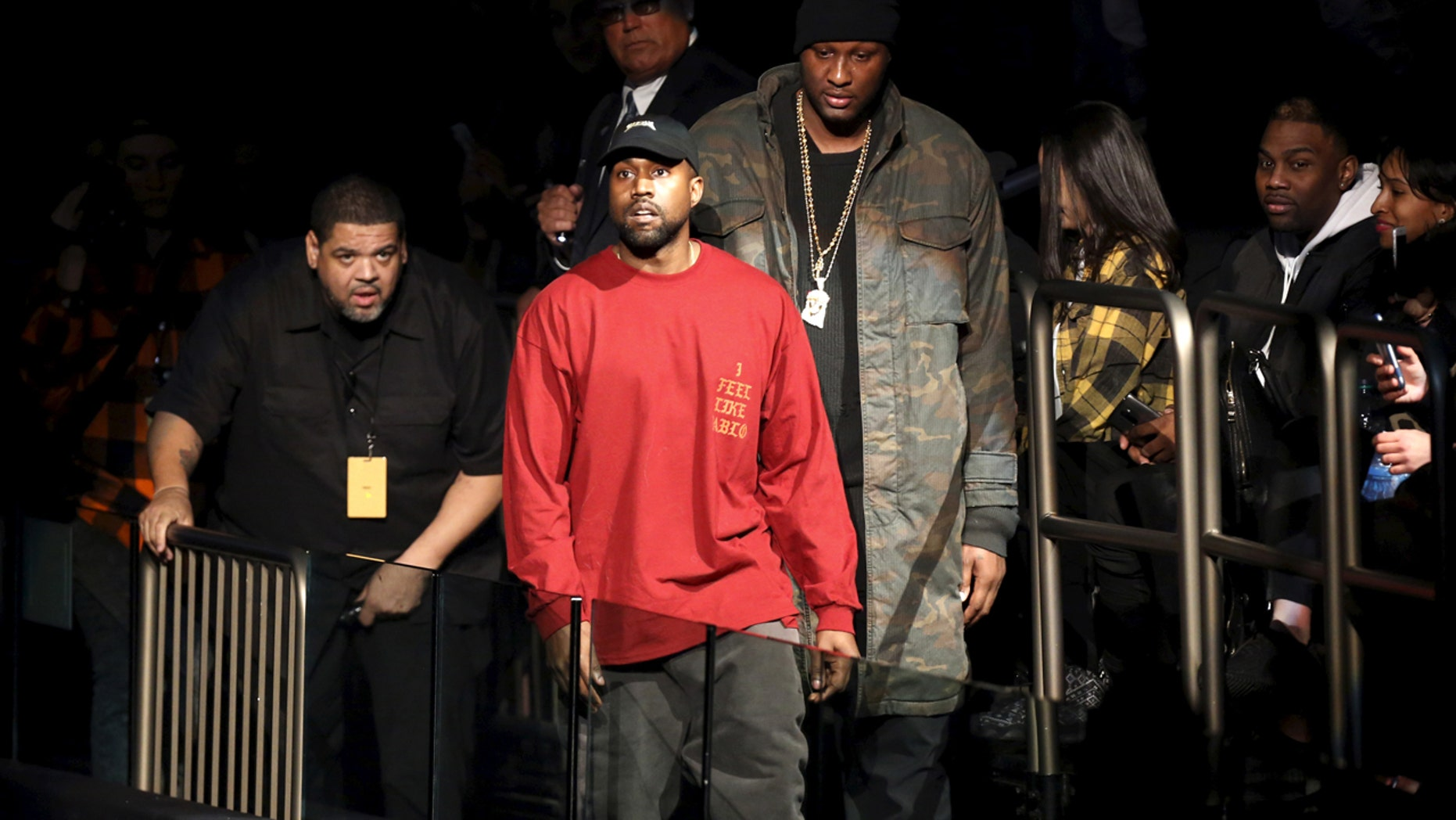 """Kanye West (C) and Lamar Odom arrive at Kanye West's Yeezy Season 3 presentation and listening party for the new """"The Life of Pablo"""" album during New York Fashion Week February 11, 2016."""
