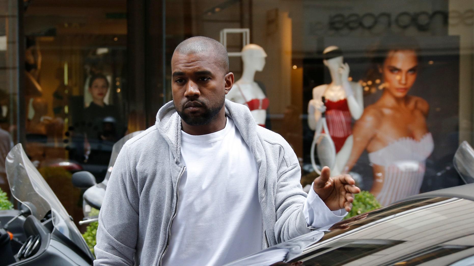 May 22, 2014. Rapper Kanye West  arrives at a fashion designer shop in Paris.