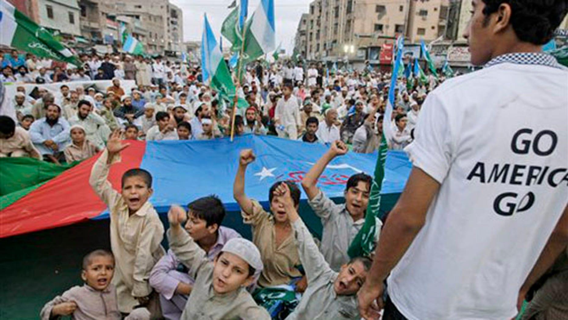 June 10, 2012: Pakistani boys chant slogans during an anti-U.S. rally organized by religious party Jamat-e-Islami in Karachi, Pakistan.