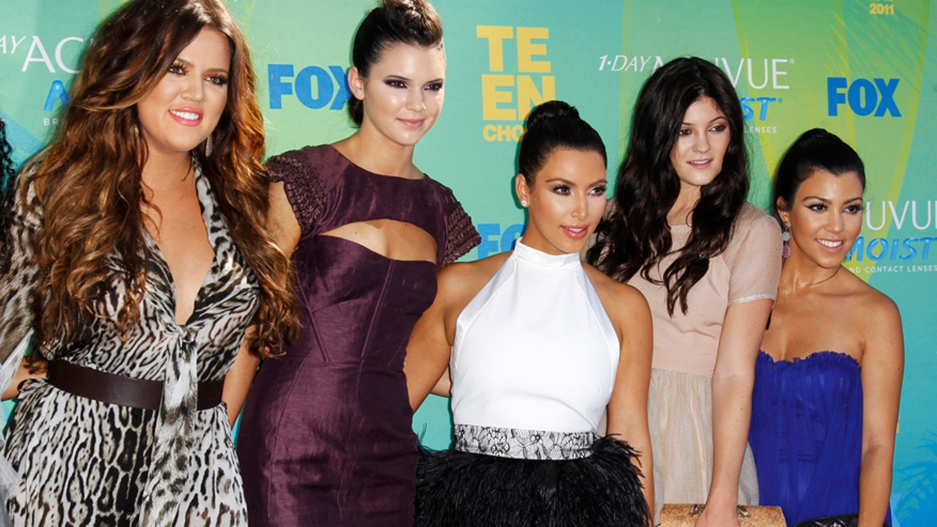 Kendall (2nd L) and Kylie Jenner (2nd R) pose with their sisters Khloe Kardashian (L), Kim Kardashian (C) and Kourtney Kardashian at the Teen Choice Awards in Los Angeles August 7, 2011.
