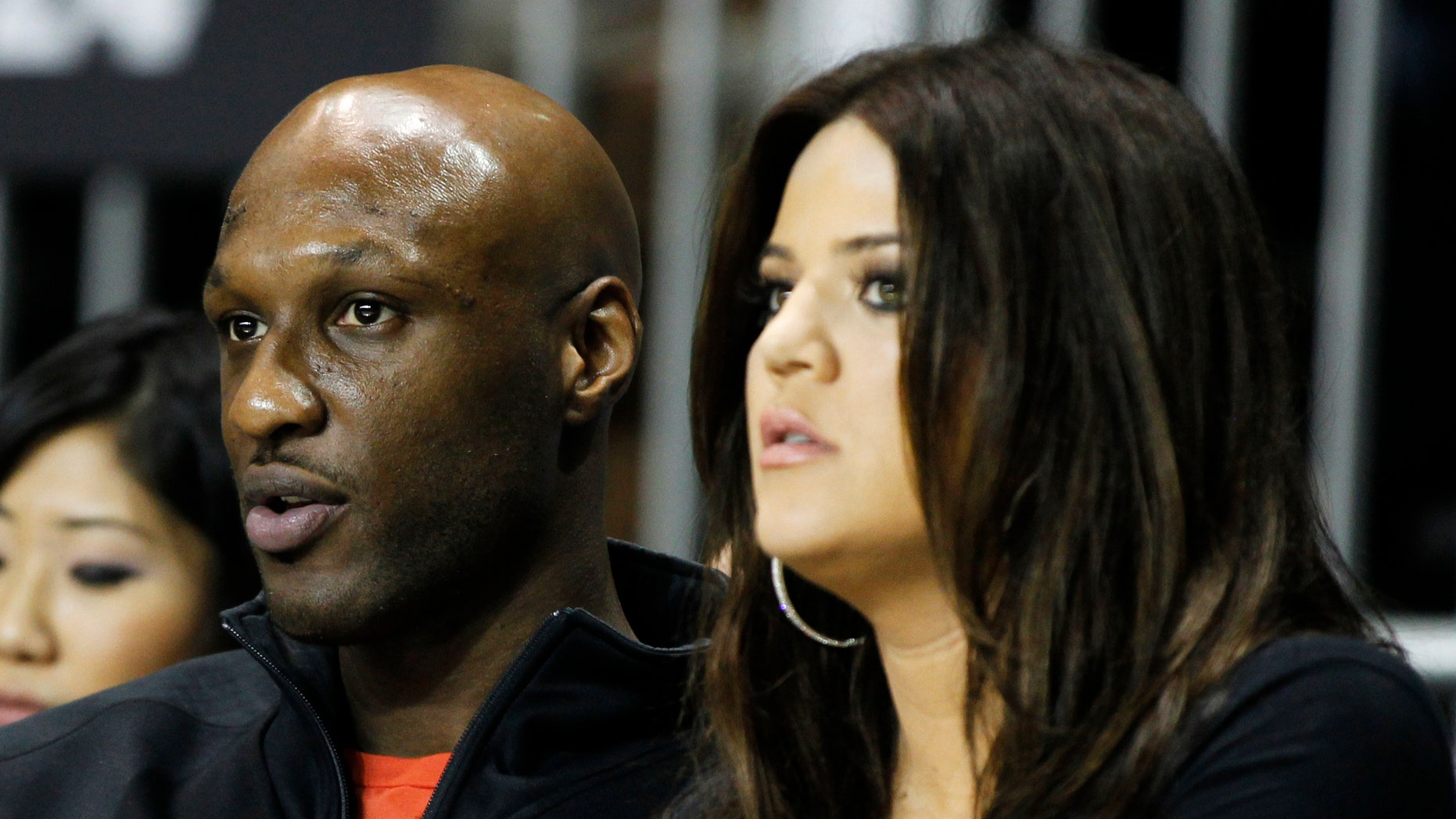 Los Angeles Lakers' Lamar Odom (L) and his wife television personality Khloe Kardashian sit courtside as they attend the 2011 BBVA All-Star Celebrity basketball game as a part of the NBA All-Star basketball weekend in Los Angeles, February 18, 2011. REUTERS/Danny Moloshok (UNITED STATES - Tags: SPORT BASKETBALL ENTERTAINMENT) - RTR2ISS6