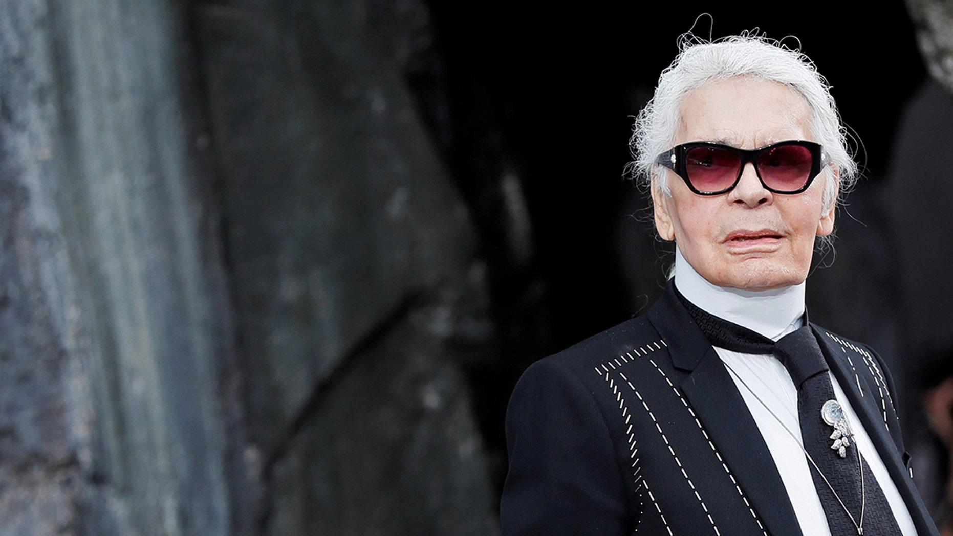 German designer Karl Lagerfeld appears at the end of his Spring/Summer 2018 women's ready-to-wear collection show for fashion house Chanel at the Grand Palais during Paris Fashion Week, France, October 3, 2017. REUTERS/Gonzalo Fuentes - RC18298D3B00