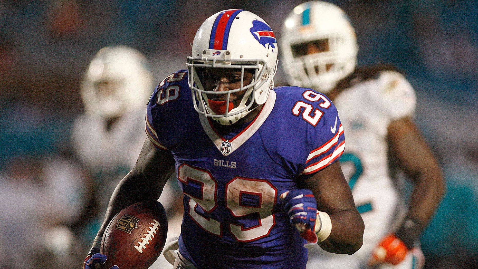 Sep 27, 2015; Miami Gardens, FL, USA; Buffalo Bills running back Karlos Williams (29) carries the ball in the second half against the Miami Dolphins at Sun Life Stadium.