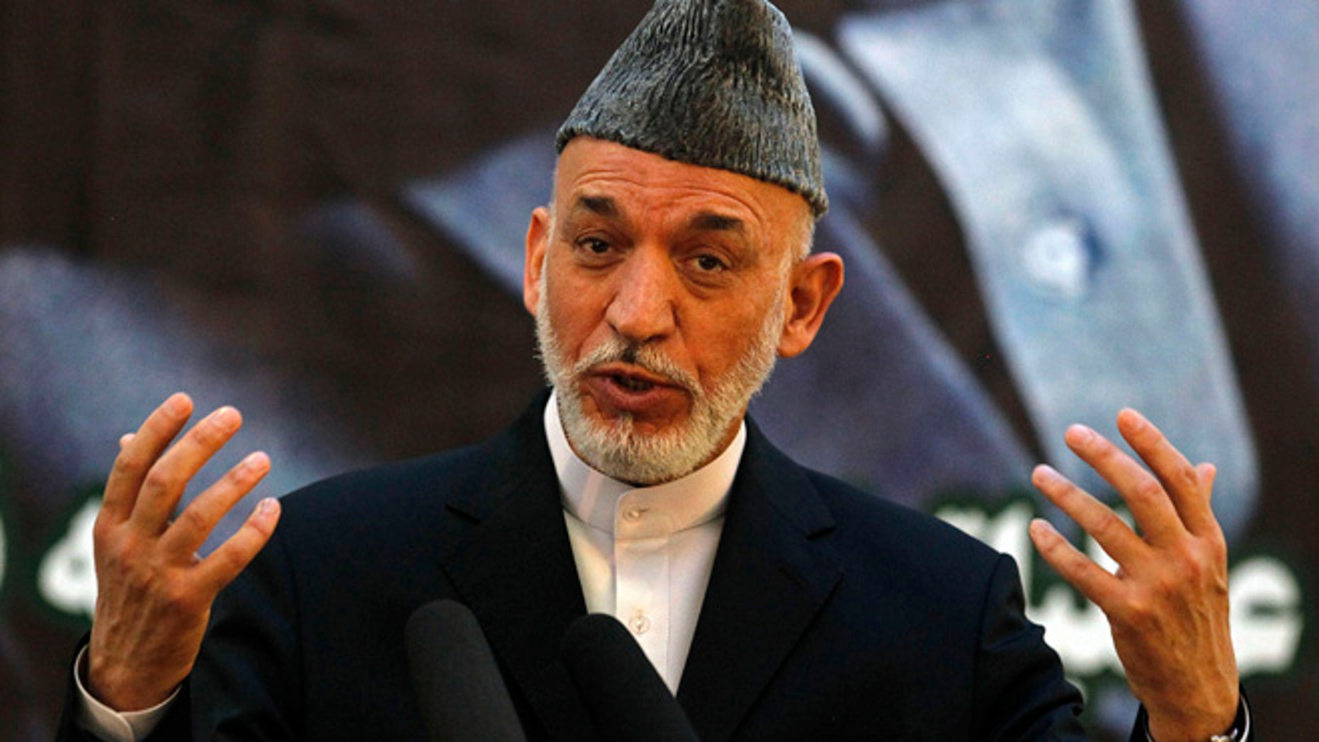 June 18, 2013: Afghan President Hamid Karzai speaks during a joint news conference with NATO Secretary-General Anders Fogh Rasmussen following a security handover ceremony at a military academy outside Kabul. Afghanistan will send a team to Qatar for peace talks with the Taliban, Karzai said on Tuesday, as the U.S.-led NATO coalition launched the final phase of the 12-year war with the last round of security transfers to Afghan forces.