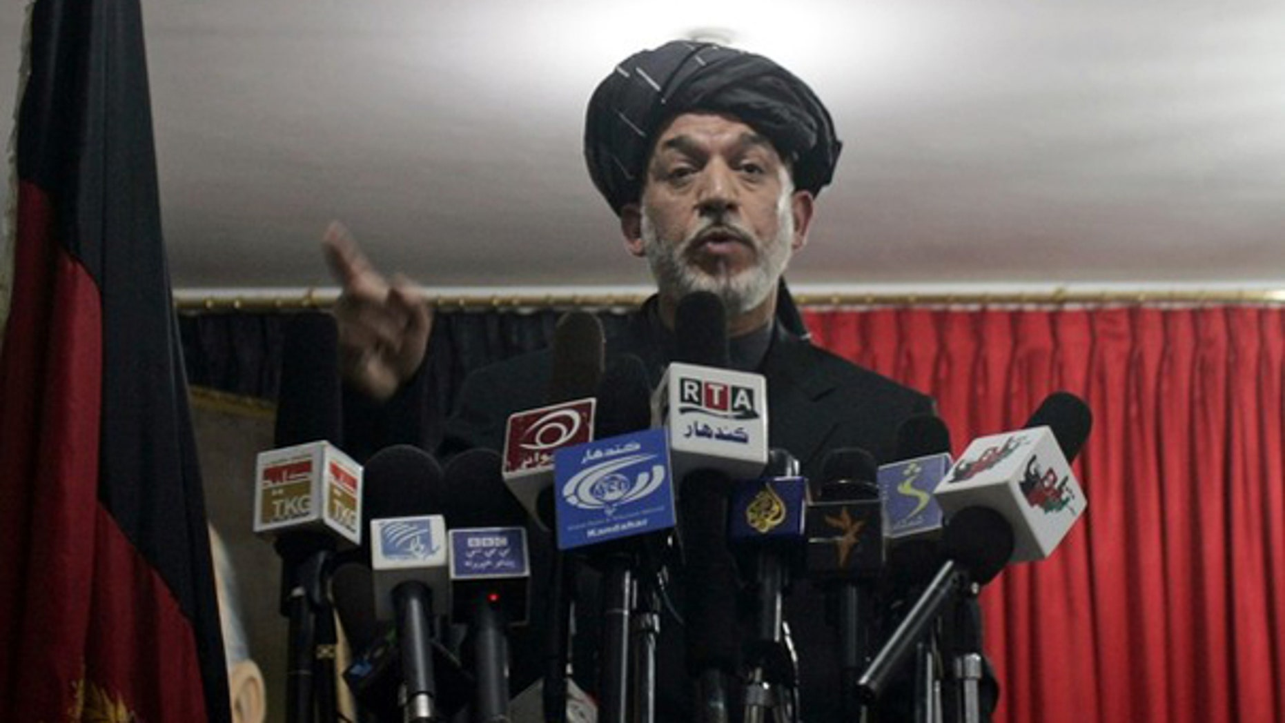Afghan President Hamid Karzai speaks at a meeting in Kandahar April 4. (Reuters Photo)